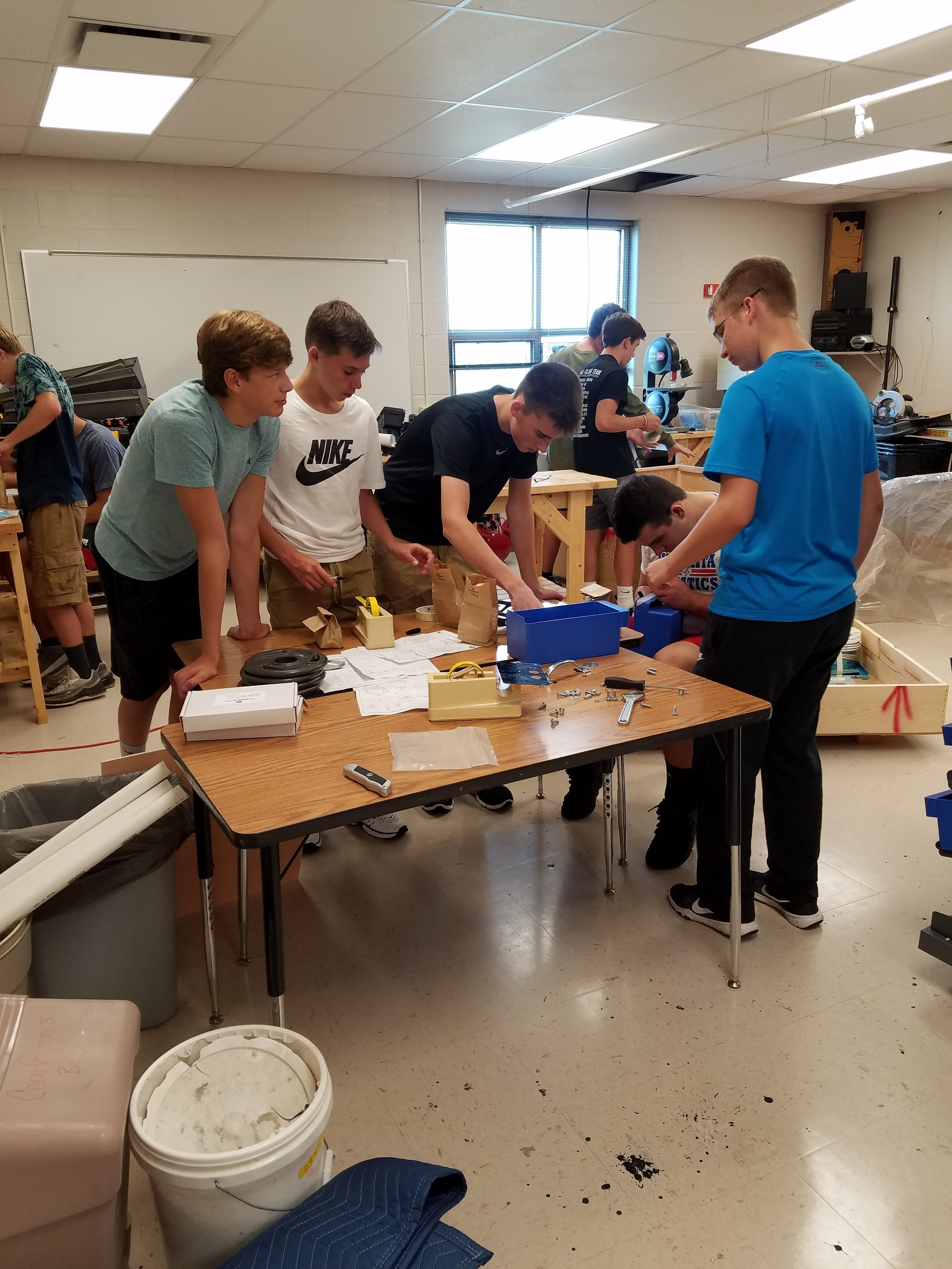 Engineering students work together on a project.
