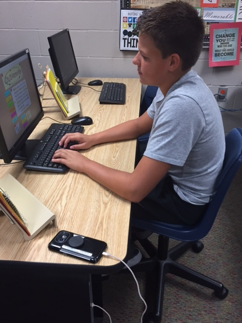 Business Communications student works on his project.