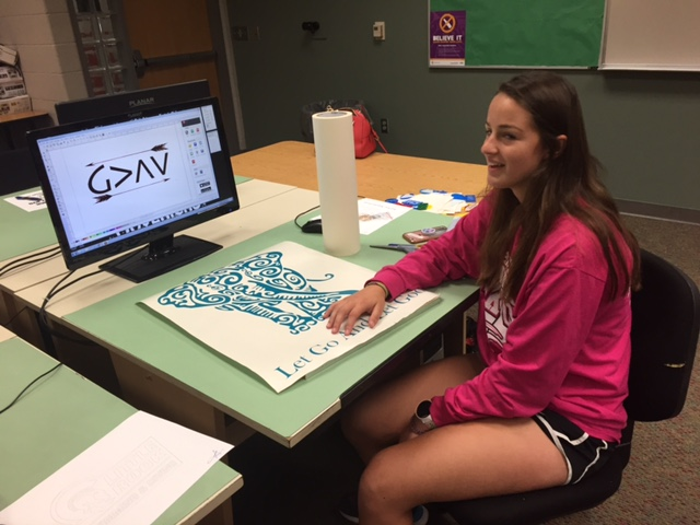 Graphic Design Student with her artwork