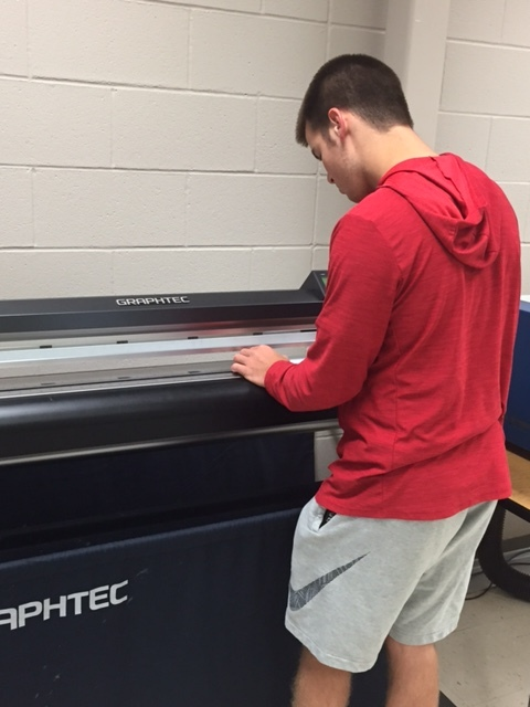 Graphic Design student works on his vinyl project.