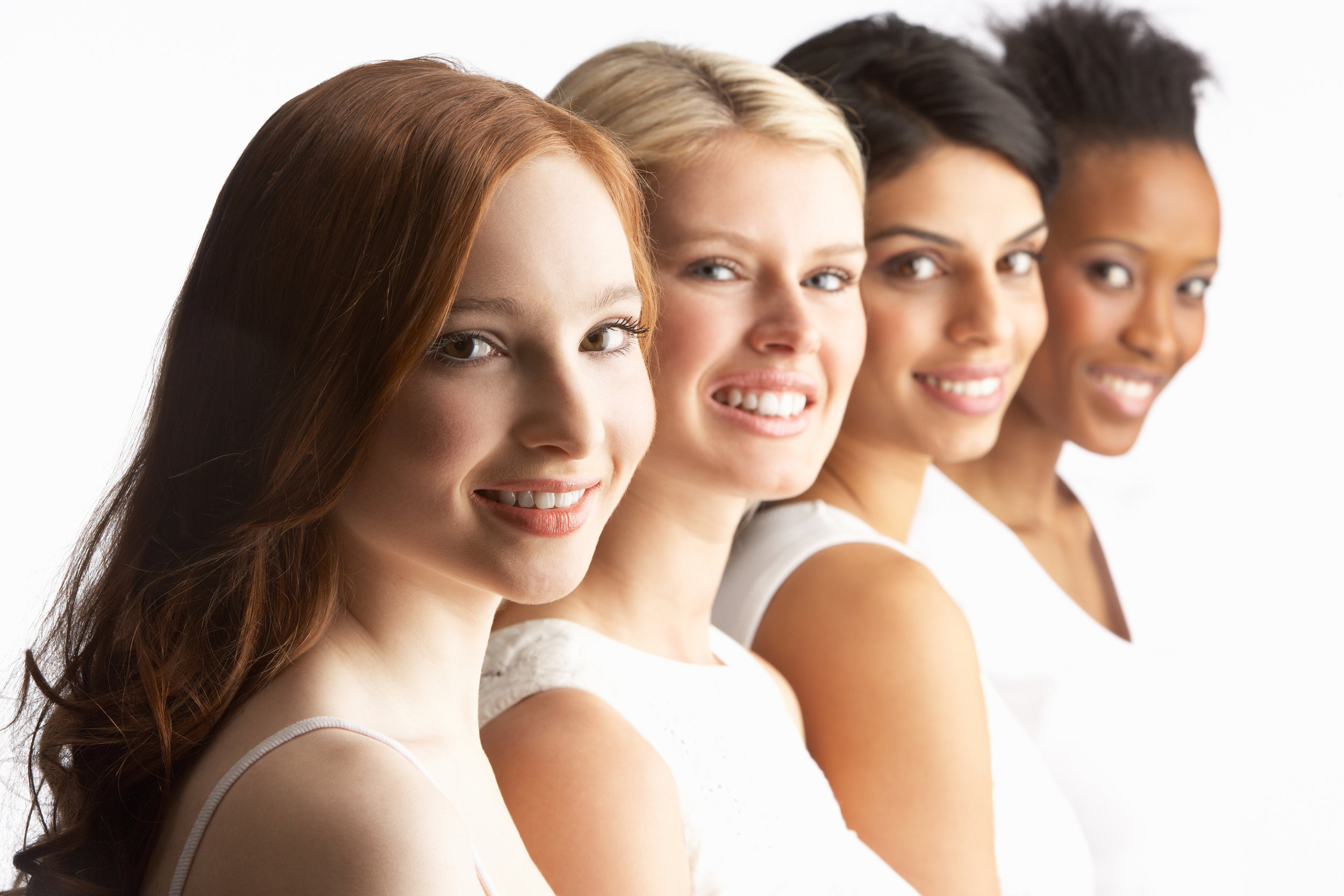 Portrait Of Four Attractive Young Women In Studio Standing In Li