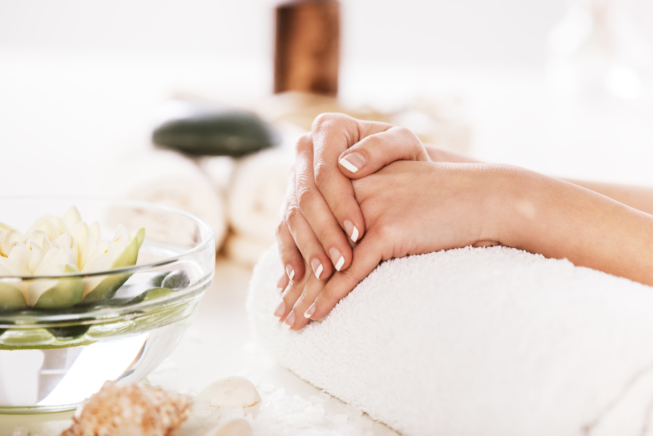 Enjoying Hand And Nail Treatment In Spa.