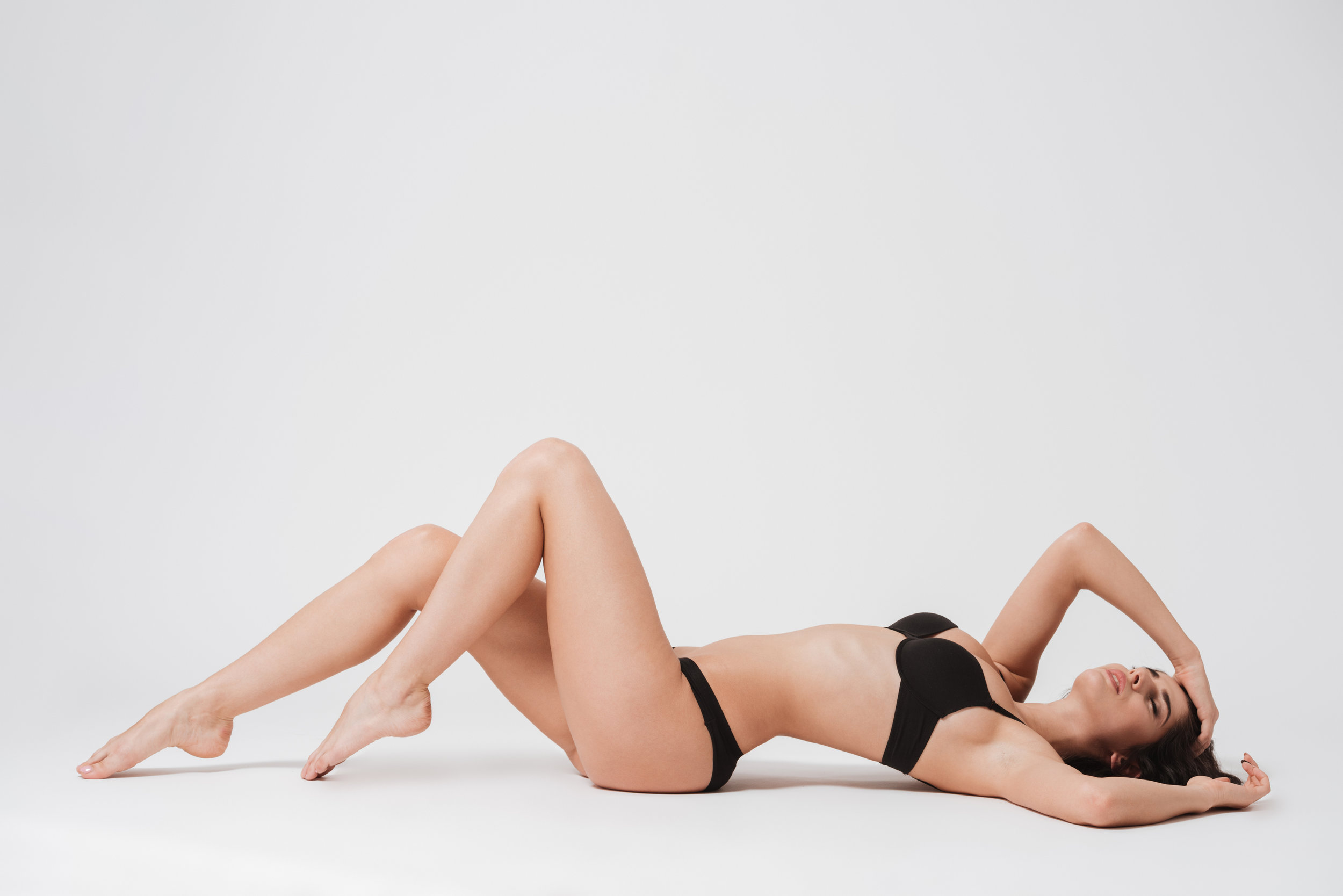 Woman laying on her back with eyes closed