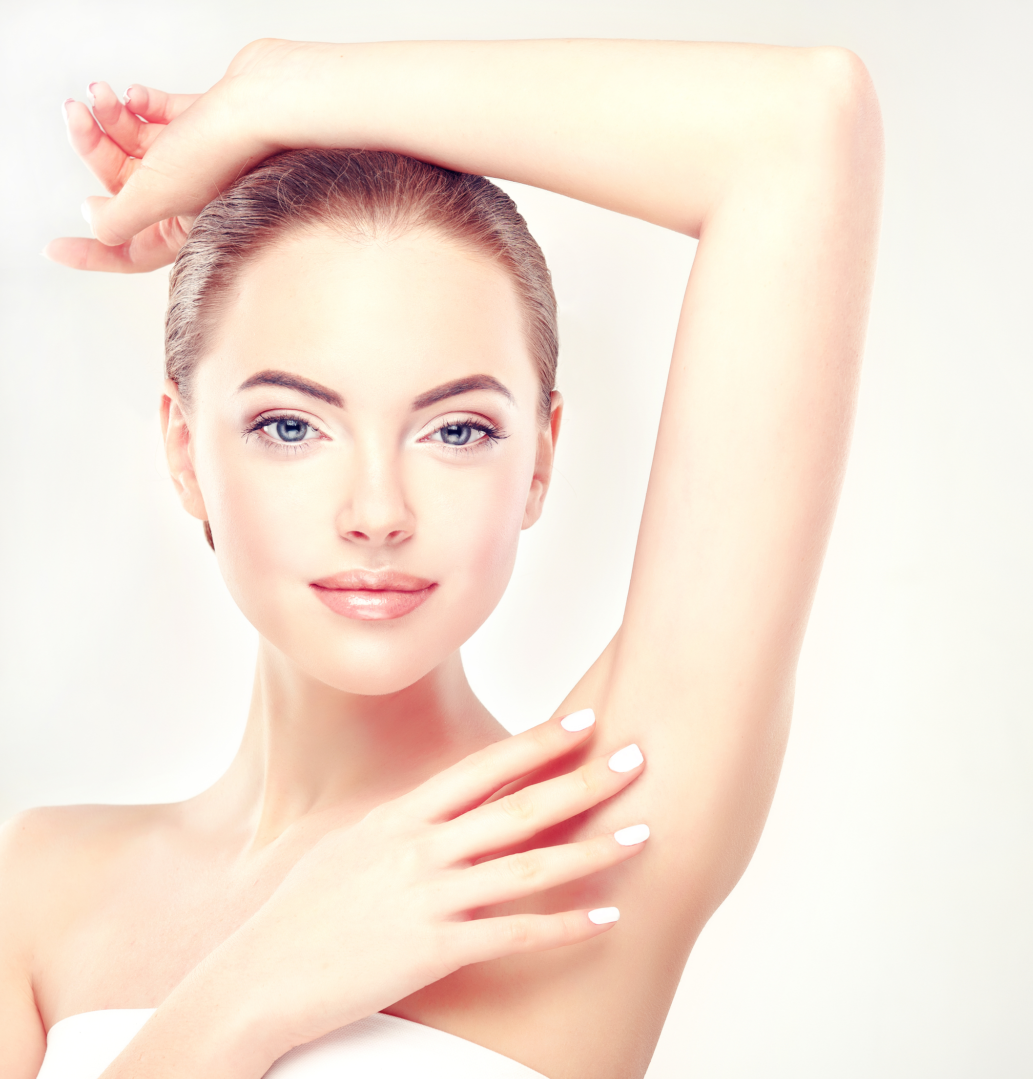 Armpit epilation, lacer hair removal. Young woman holding her arms up and showing underarms, armpit smooth clear skin .Girl showing clean armpit .Beauty portrait.Epilation and depilation of hair .
