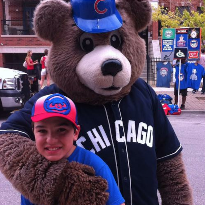 Dominic   Dominic loves his brother, sister, niece & nephew, and as you can see, is a die-hard Cubs fan! Not to mention, in his spare time, he loves to bake! He's a very talented young man with many exciting hobbies. We want to see him thrive in the best environment, and you can help make that possible! Please consider redirecting your tax dollars to help keep Dominic at PS Academy.   Read Dominic's full story >