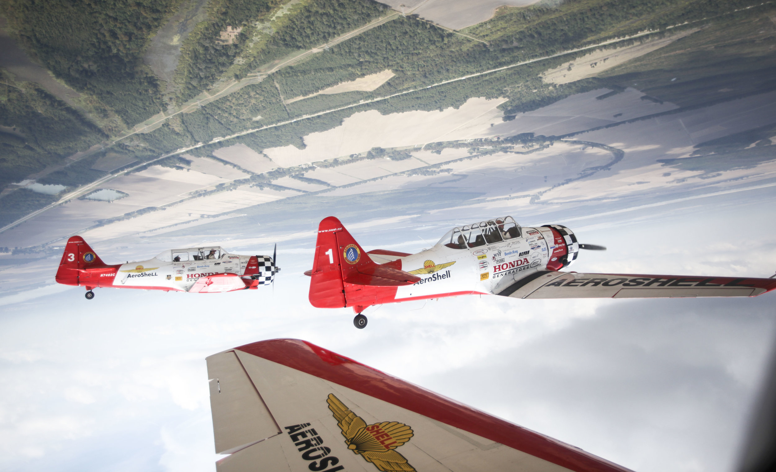 The Aeroshell Aerobatic Team flies North American AT-6 Texans upside down during ride-a-longs ahead of the Southern Heritage Air Foundation's Twilight Air Show and The Best Little Airshow in the World at the Vicksburg-Tallulah Regional Airport in Tallulah, La on Thursday October, 11, 2018.