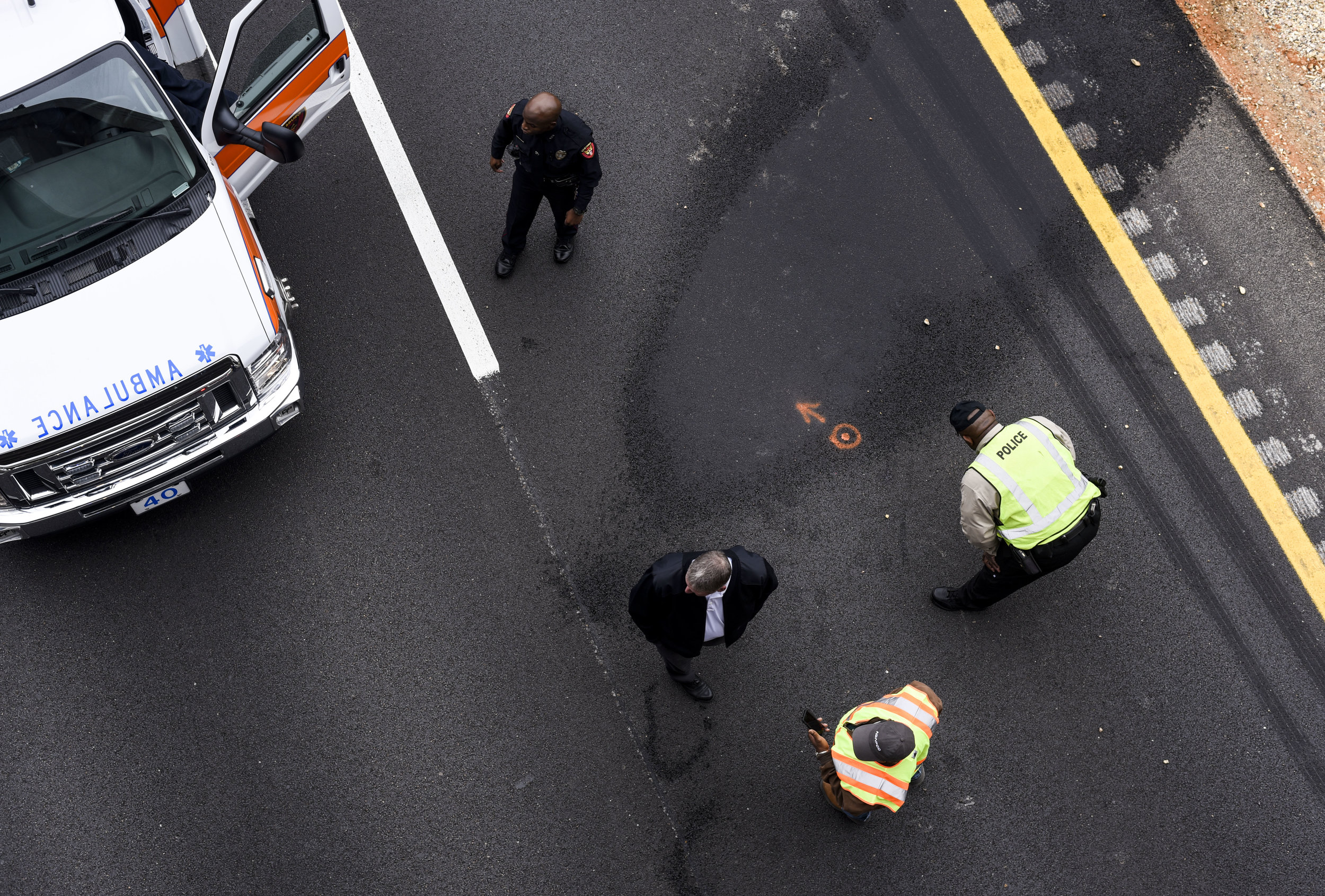 Vicksburg first responders inspect the site of where 29-year-old Jeffery Casper jumped from the Halls Ferry bridge onto Interstate 20 East at 10:37 a.m. on Wednesday morning, Dec. 21, 2016 in Vicksburg, Miss. Casper was transported by ambulance to Merit Health River Region where he then died from his injuries.