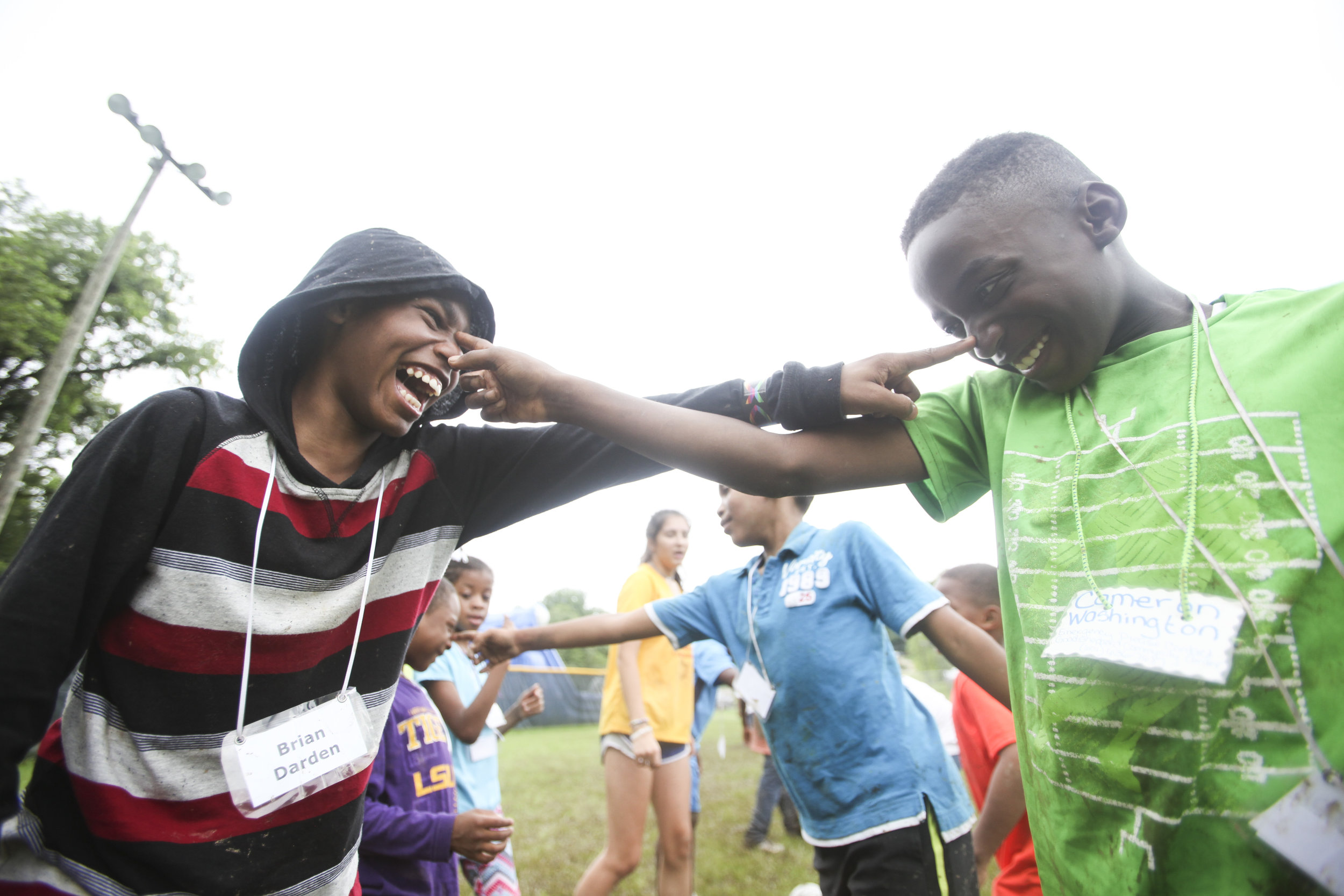 Brian Darden and Cameron Washington laugh while having to touch each other's nose during a concentration drill during the Salvation Army's Kicks for Hope Soccer Camp and Vacation Bible School Friday. Kids participated in soccer camp in the mornings with soccer coaches and then moved to Vacation Bible School throughout the rest of the day. (Courtland Wells/The Vicksburg Post)