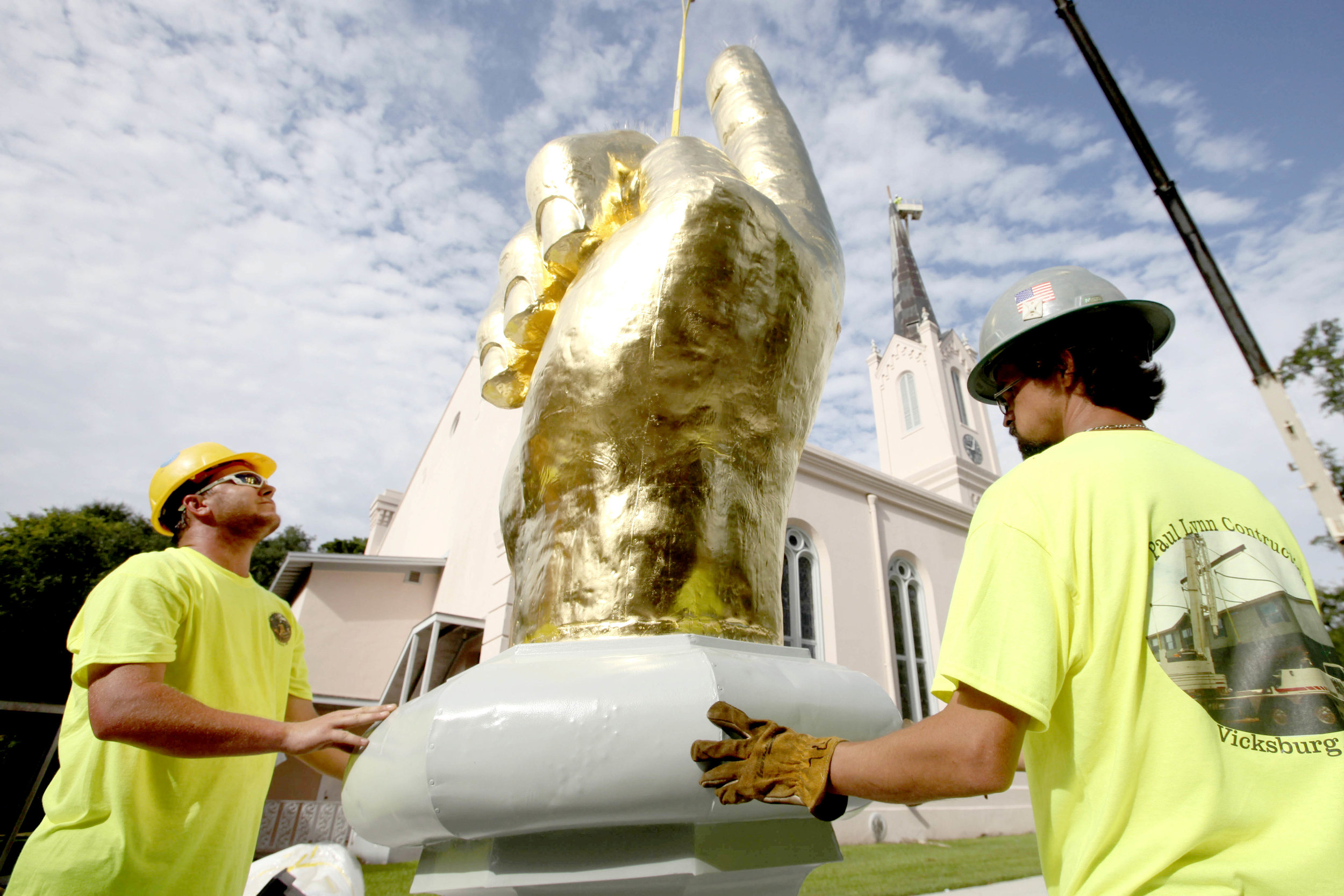 Workers with Paul Lynn Construction of Vicksburg prepare The Hand Pointing to Heaven to be placed atop the  First Presbyterian Church of Port Gibson Steeple Wednesday.  (Courtland Wells|The Vicksburg Post)