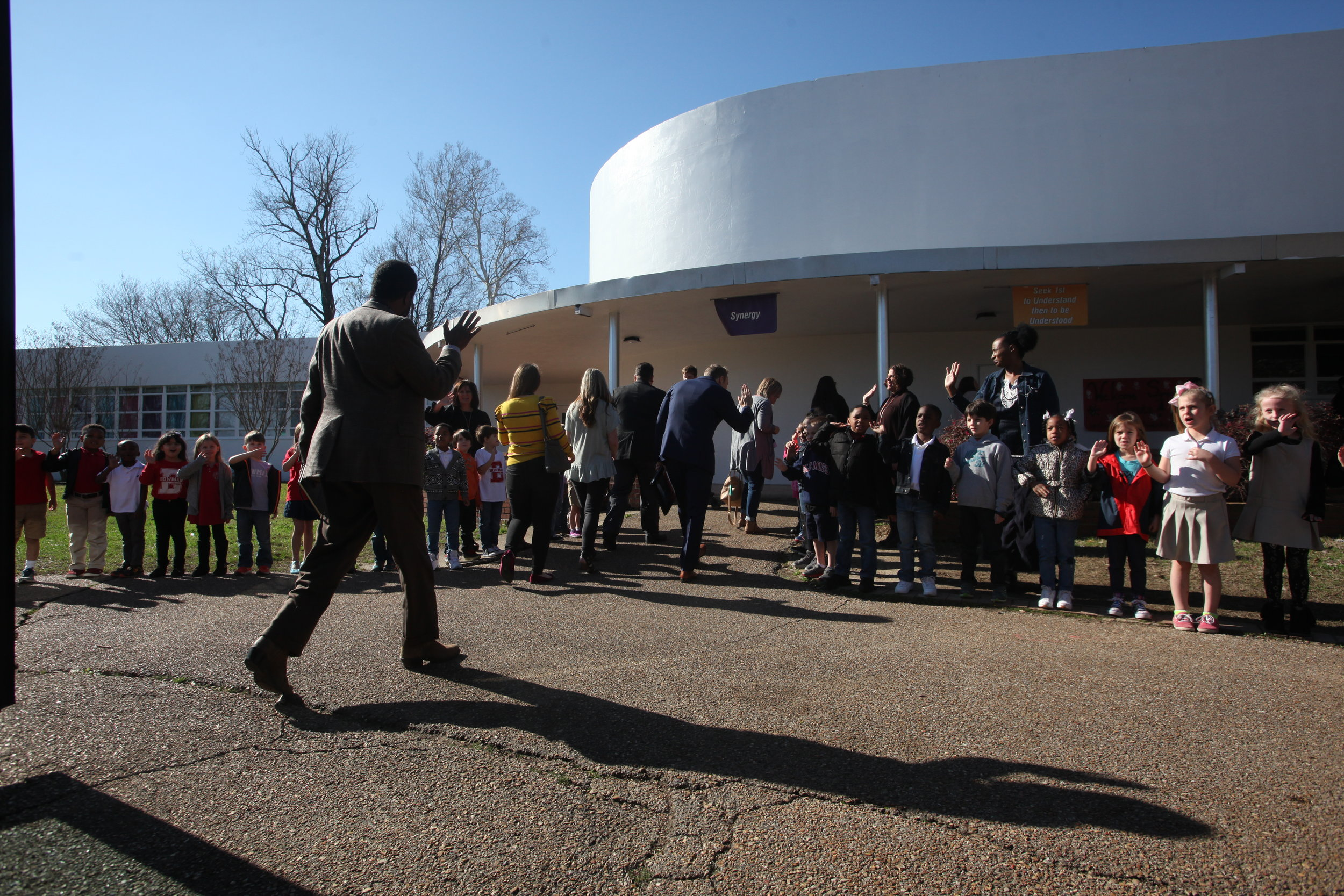Bowmar Elementary students greet educators as they exit the bus for tours at Bowmar Elementary School as part of the Leader in Me Symposium Friday. (Courtland Wells/The Vicksburg Post)