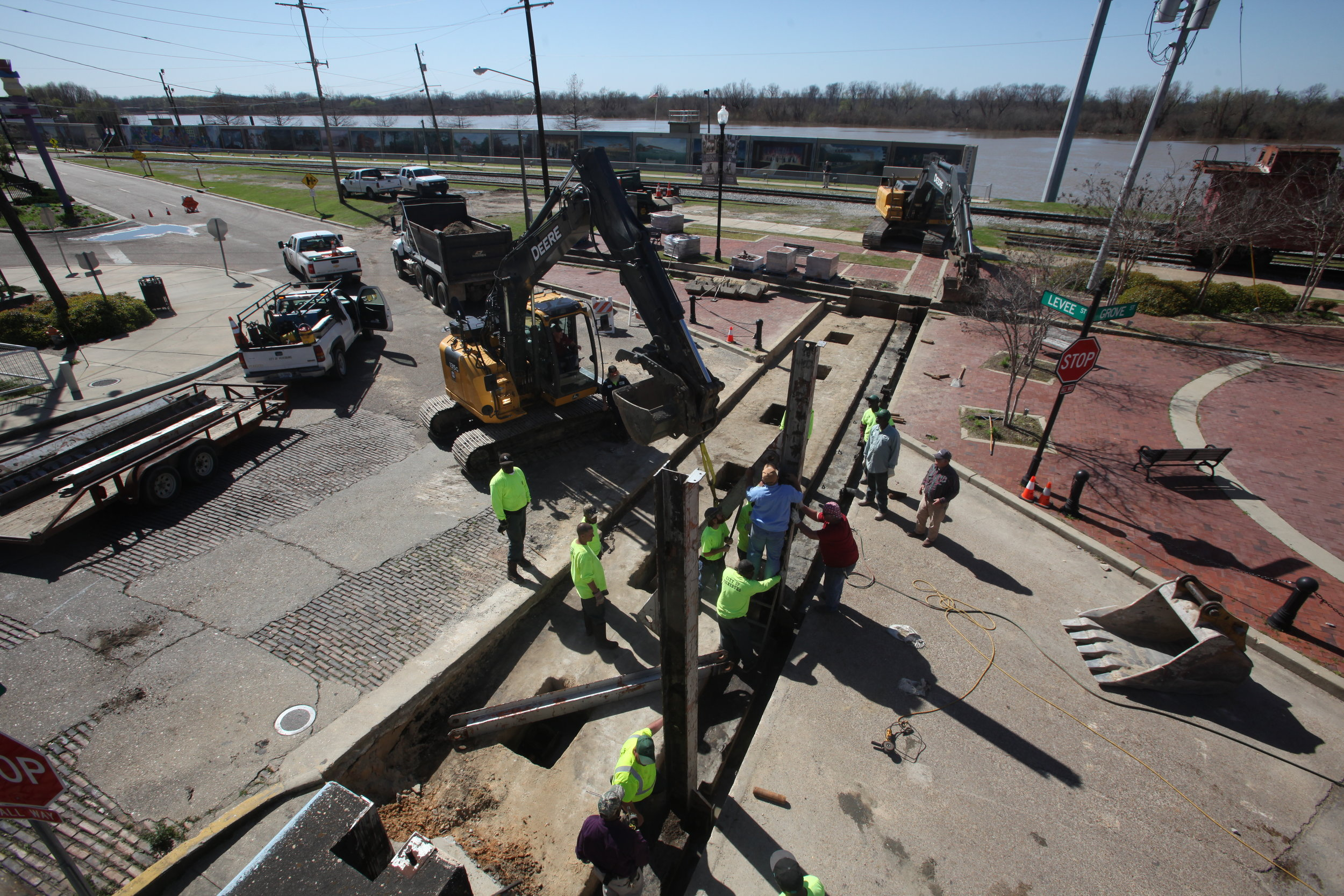 Workers with the City of Vicksburg work to install the Levee Street flood wall Tuesday. The Mississippi River at Vicksburg is predicted to crest at 50.5 feet at Vicksburg on March 17th. (Courtland Wells/The Vicksburg Post, via AP)