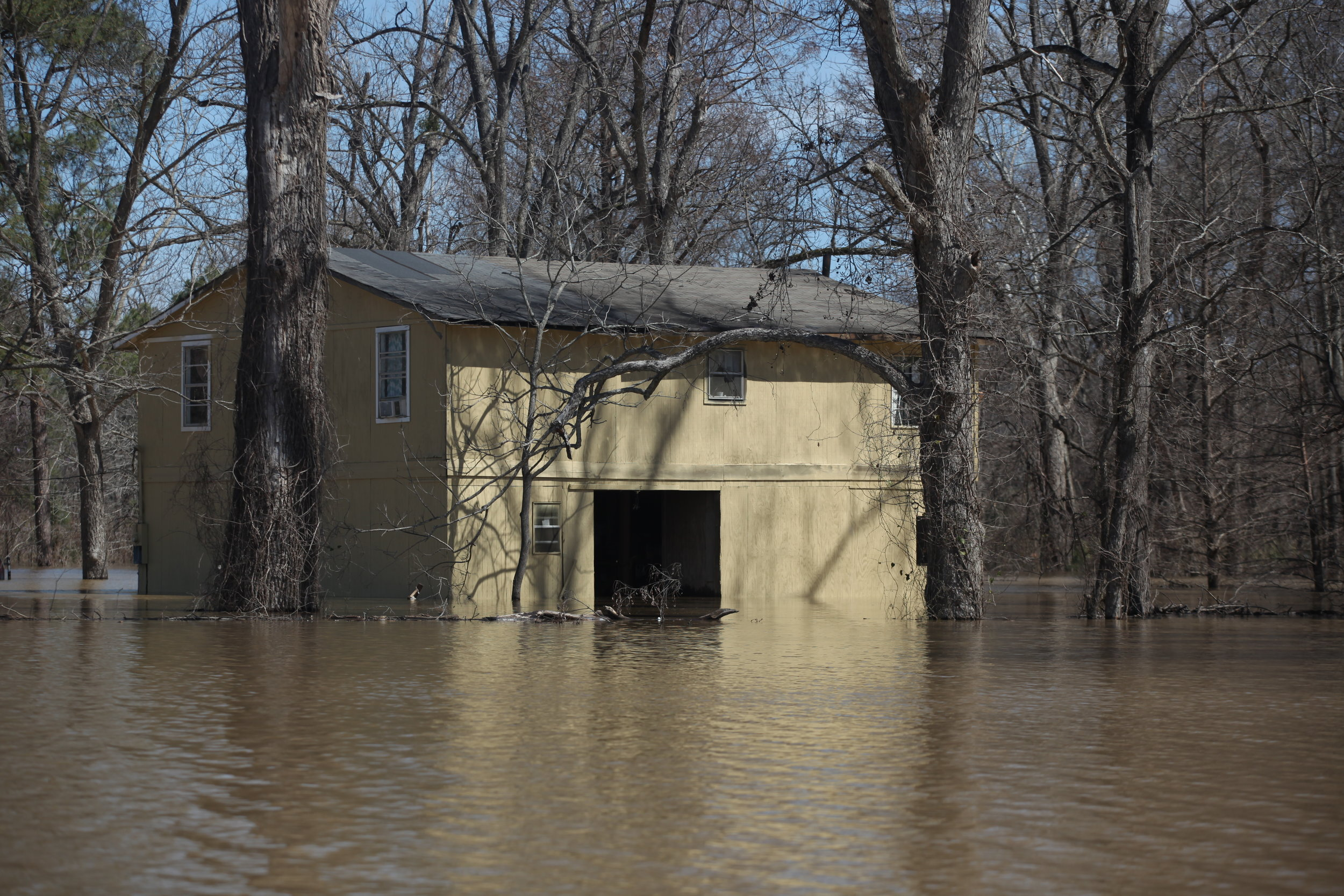 A house on Chickasaw Lane seen surrounded by floodwaters in Vicksburg, Miss., Tuesday, March 13, 2018. (Courtland Wells/The Vicksburg Post, via AP)