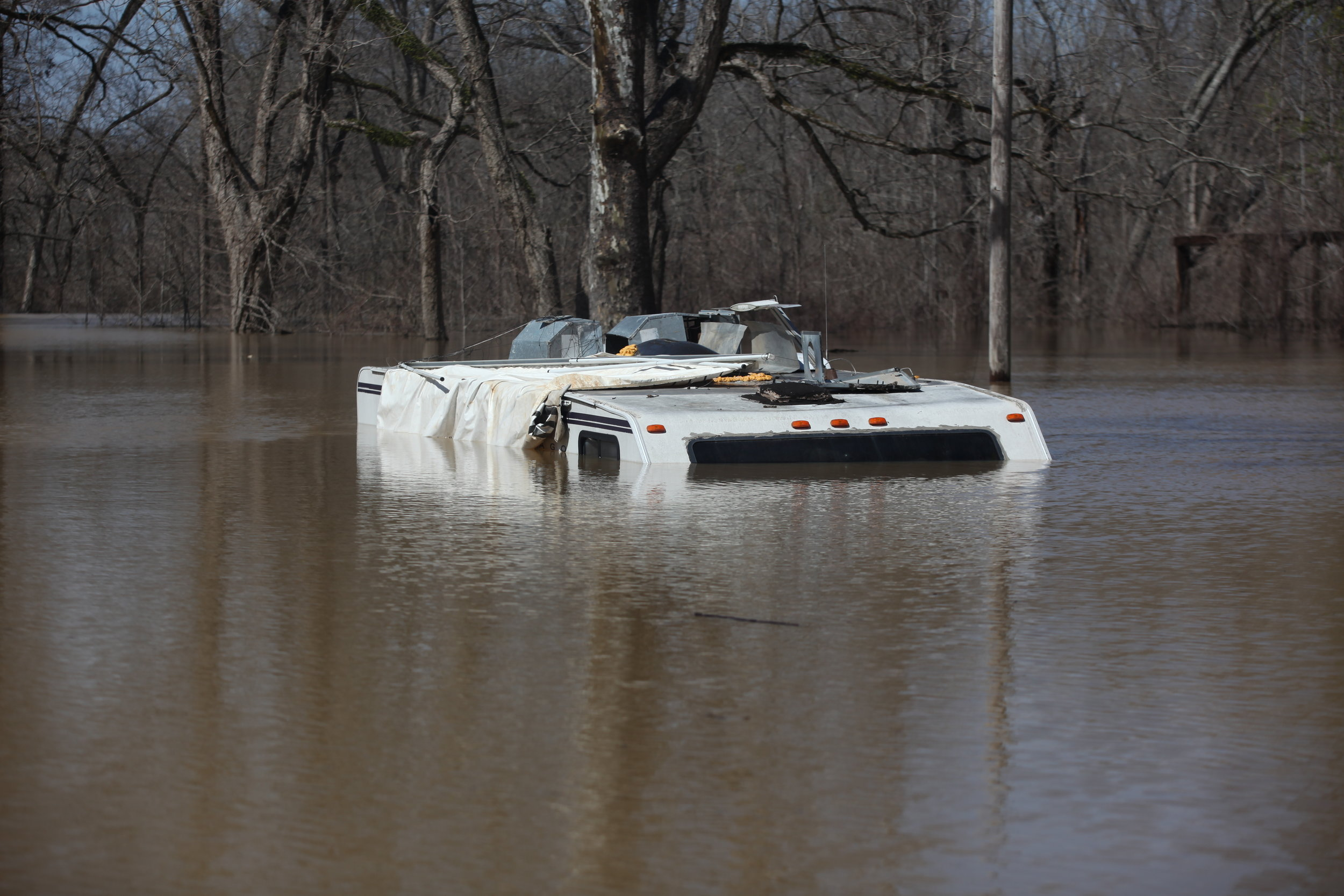 A camper on Chickasaw Road is seen inundated by floodwaters in Vicksburg, Miss., Tuesday, March 13, 2018. (Courtland Wells/The Vicksburg Post, via AP)