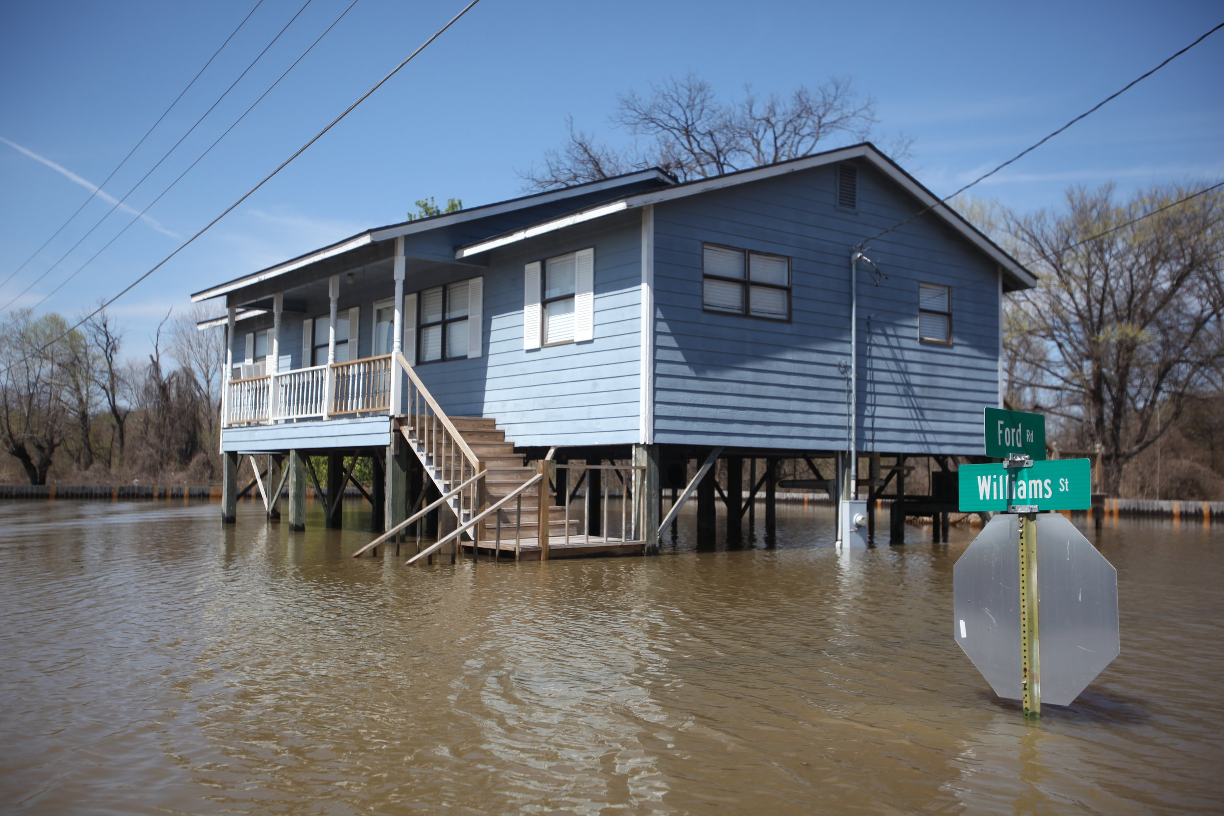 A house at the intersection of Ford Road and Williams Street is seen surrounded by floodwaters in Vicksburg, Miss., Tuesday, March 13, 2018. (Courtland Wells/The Vicksburg Post, via AP)