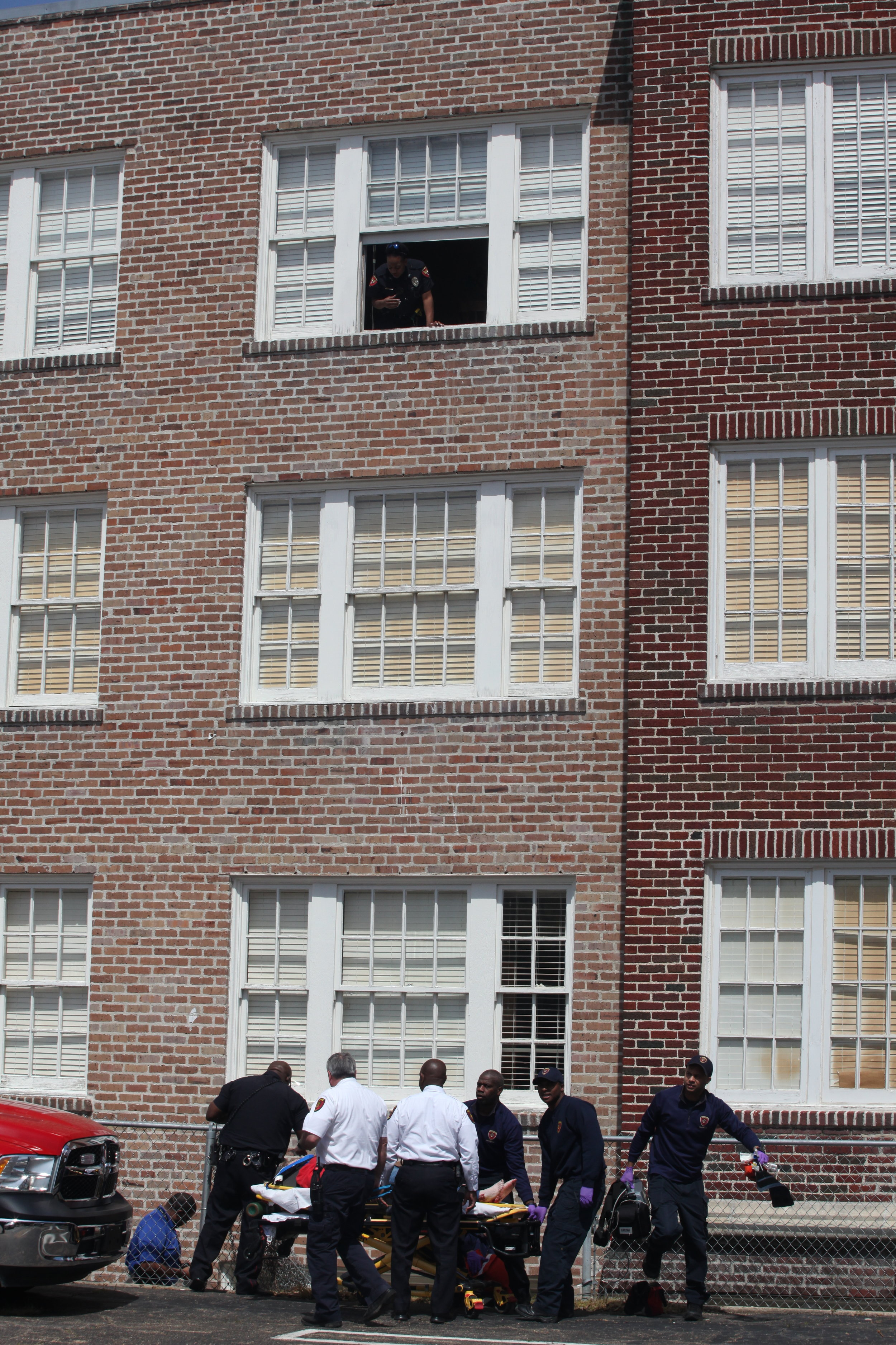 A woman who is believed to have jumped from the fourth floor of the Aeolian Senior Apartments is lifted onto a stretcher to be transported for medical attention around 12:40 p.m. Thursday (Courtland Wells/The Vicksburg Post)