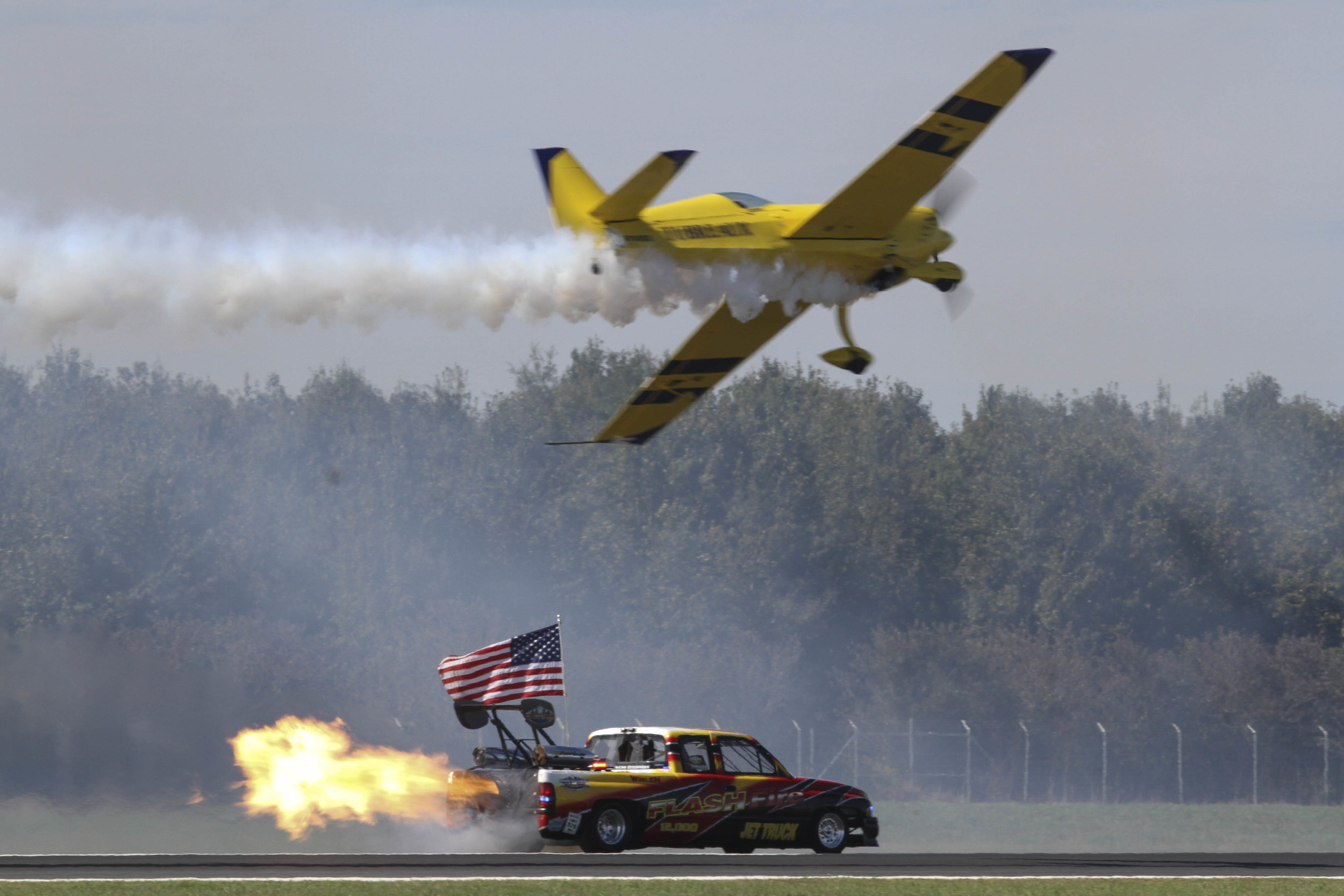 Pilot Kevin Coleman, flying the Extra 300 SHP, flies over Neal Darnell in the Flash Fire Jet Truck during the Southern Heritage Air Foundation's 2018 Best Little Airshow in the World at the Vicksburg-Tallulah Regional Airport Saturday (Courtland Wells/The Vicksburg Post)