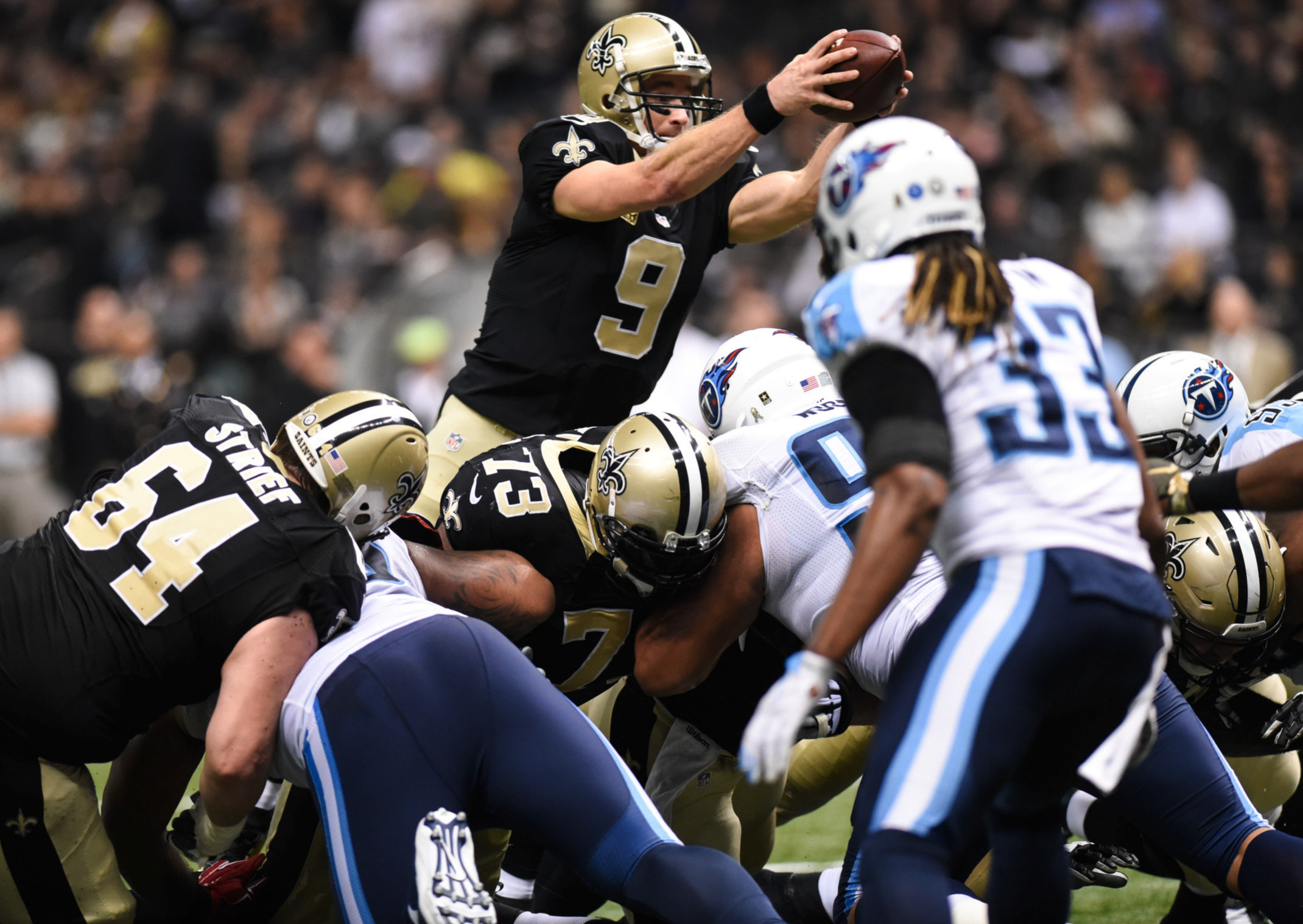 Drew Brees (9) scores a one yard touchdown dive against the Titans defense at the Mercedes-Benz Superdome in New Orleans. Sunday Nov. 8, 2015. The Saints fell to the Titans 34-28 in overtime.