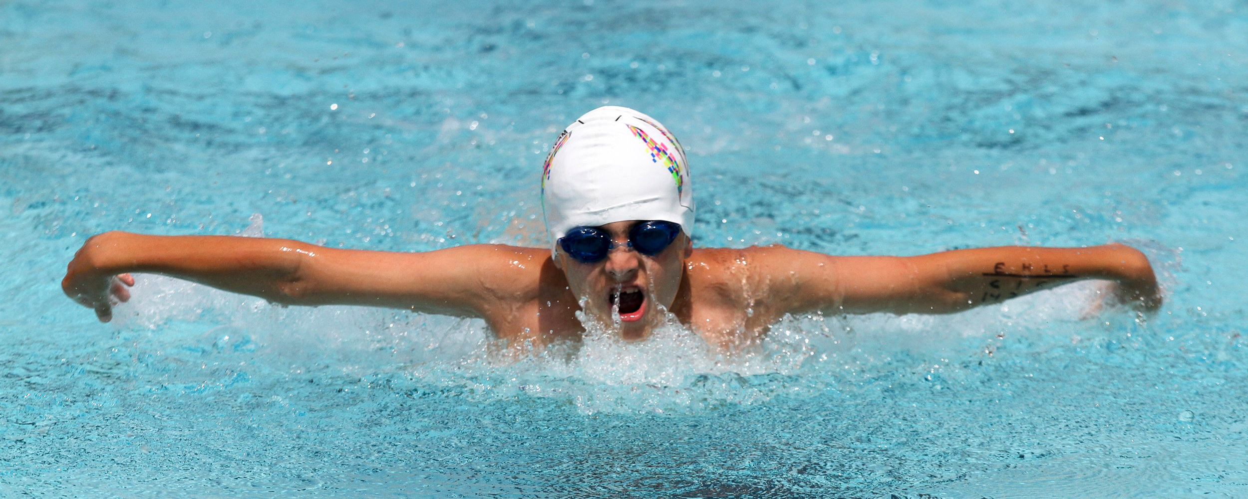 Tulio Figarola competes in the 8 and under 25 yard butterfly during the Stamm Family Invitational Swim Meet Sponsored by Vicksburg Swim Association Friday at the Vicksburg City Pool.  The Stamm Family Invitation Swim Meet is in Memory of Alan Ebersole and will continue all weekend. (Courtland Wells/The Vicksburg Post)