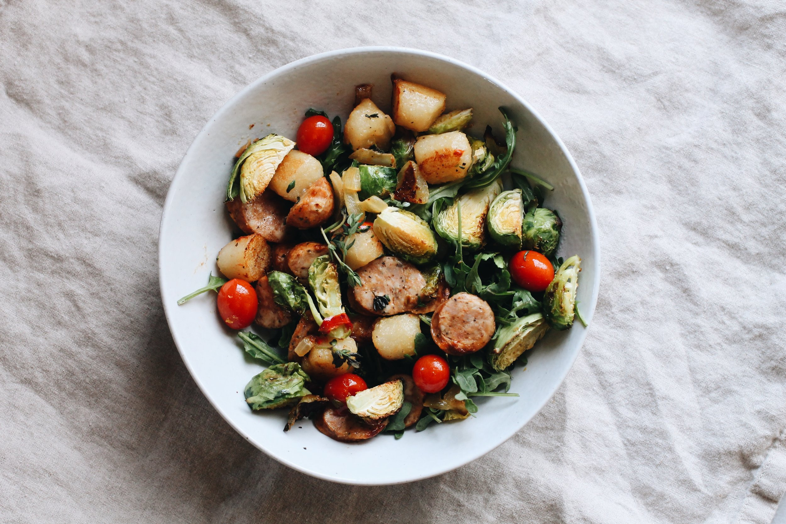 Cauliflower Gnocchi with Fresh Thyme, Chicken Sausage, and Brussels.JPG