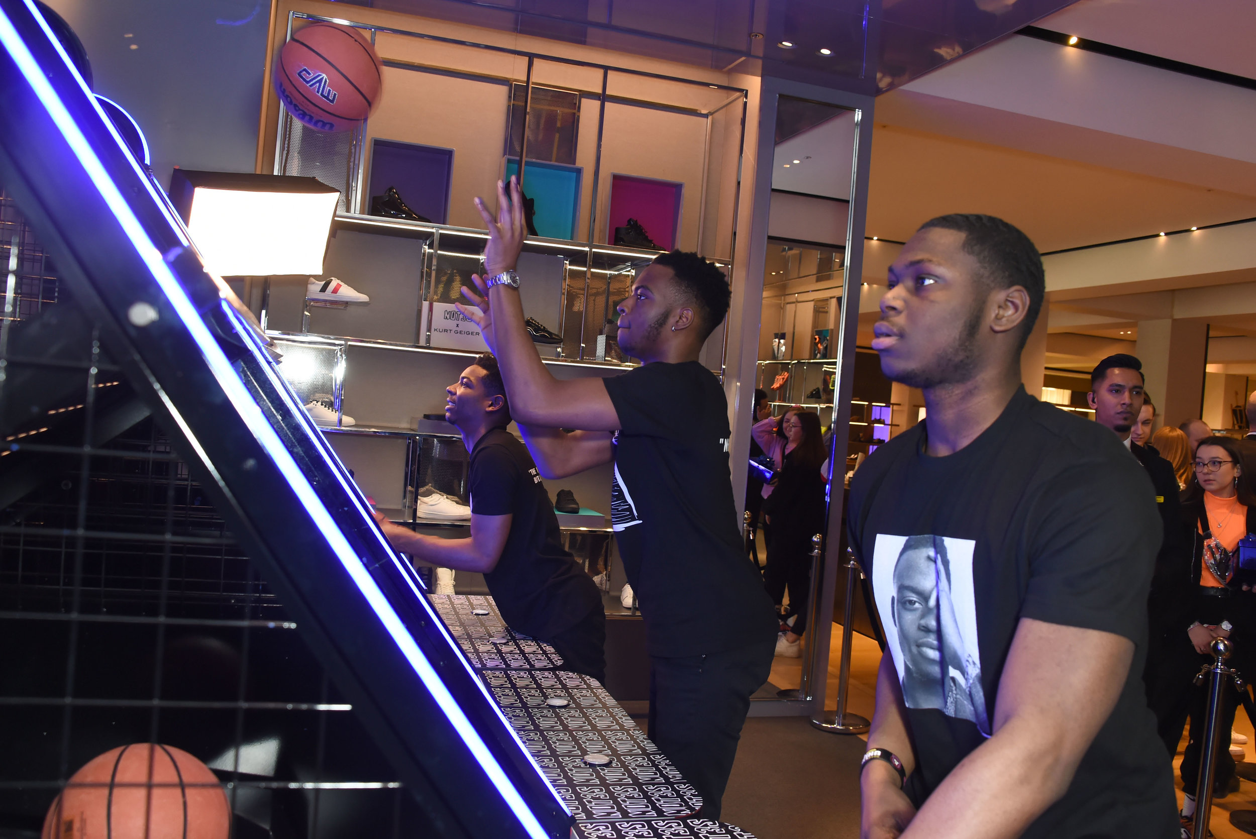 Not3s and friend playing basketball at the in store event at Selfridges London