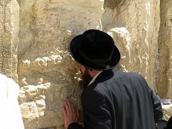 Praying at the Western Wall of the Temple in Jerusalem
