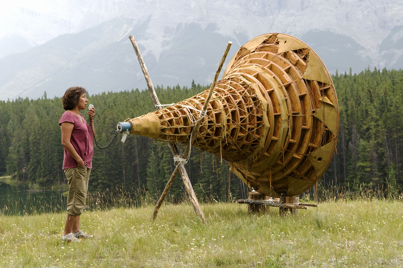 Rebecca Belmore activating her work Ayum - ee-aawach Oomama-mowan: Speaking to Their Mother , (1991) at Johnson Lake, Banff National Park, as part of the exhibition  Bureau de Change , presented by the Walter Phillips Gallery, Alberta, Canada, 2008