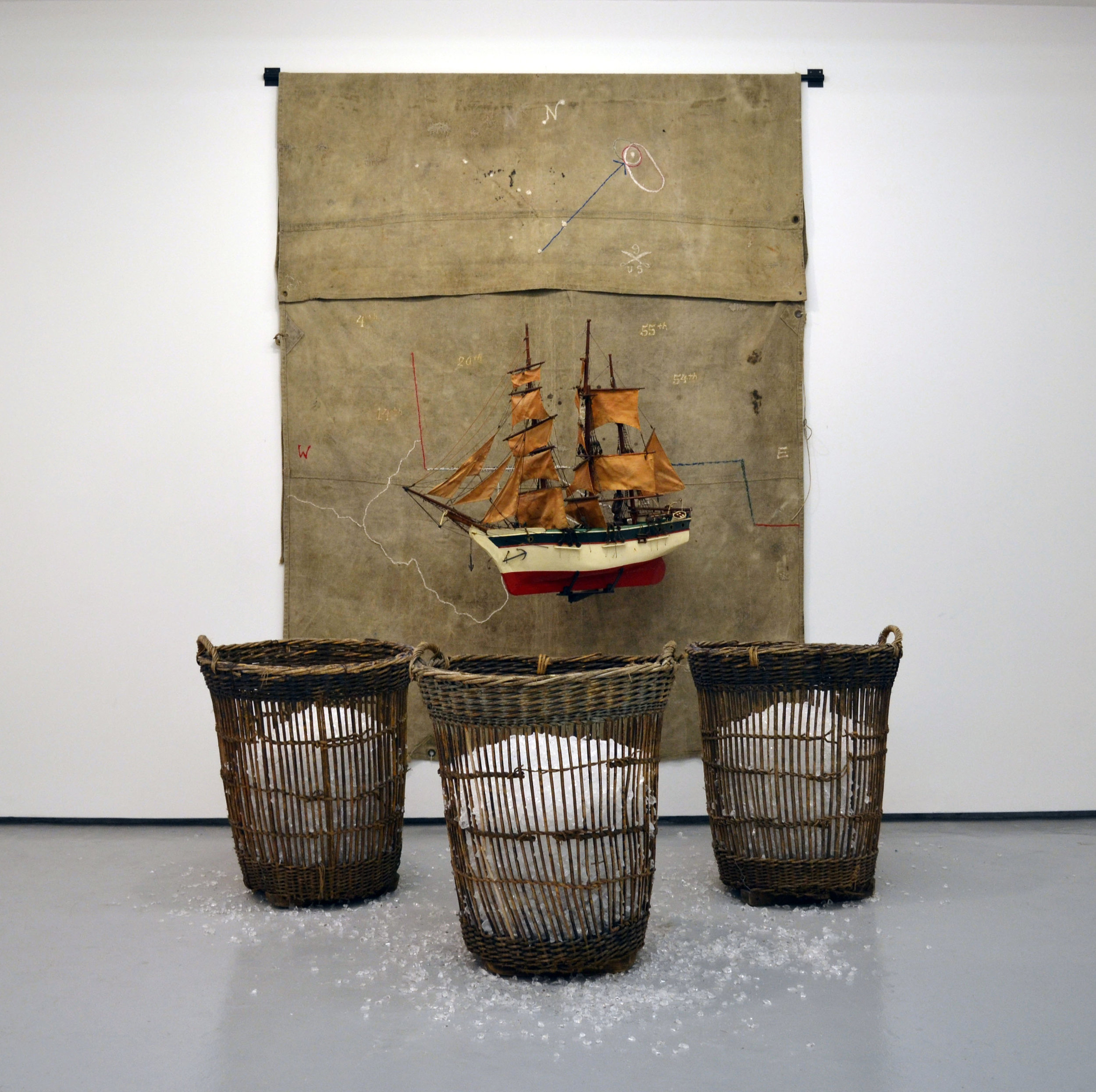 RADCLIFFE BAILEY, Vessel , 2012, tarp, iron, vintage model ship, wicker basket, and glass, 120 x 188 x 89 inches Courtesy of the artist and Jack Shainman Gallery, New York