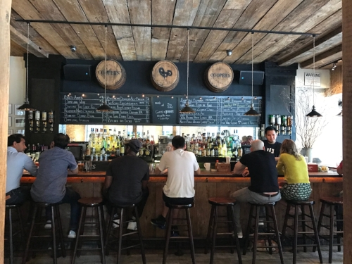 A view of the bar at Cooper's Craft & Kitchen. Look at that beer list!