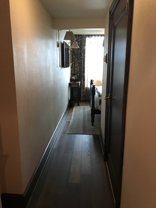 Our view when we unlocked our door. Clean, modern, and neat designs are noticeable, as is the room's size.
