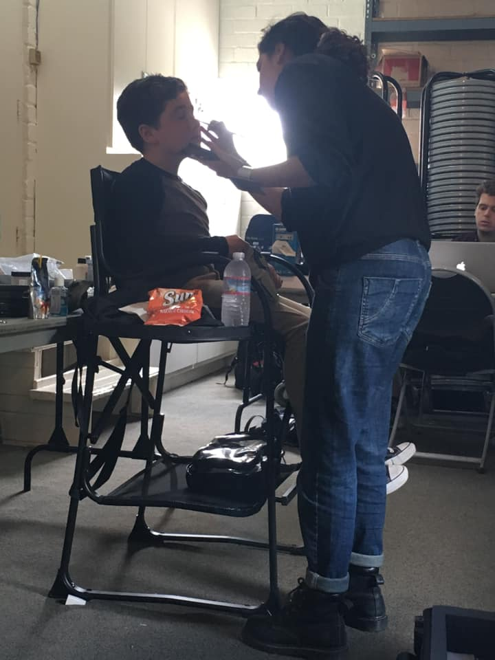 Max Page gets his makeup done in the theater.