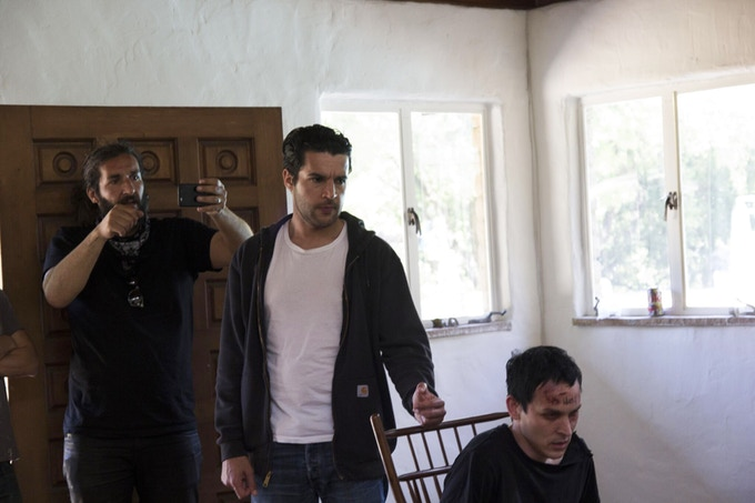 Actors Christopher Abbott and Robin Lord Taylor rehearse and block a scene for Cinematographer Carlos Veron.