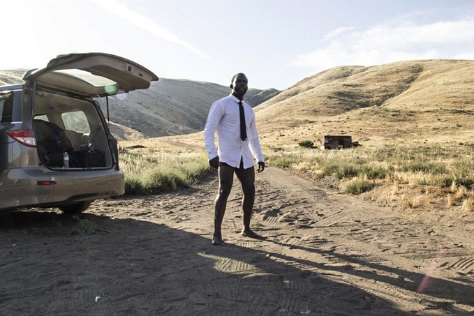 Actor Jimmy Akingbola stays cool between takes in the desert.