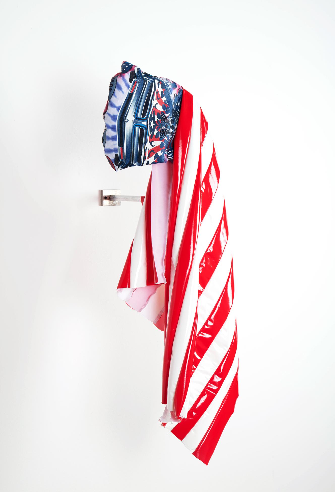 USA (legendary, power), 2017  Goodwill t-shirt, vinyl fabric, aluminum, hardware  16x39x15 inches