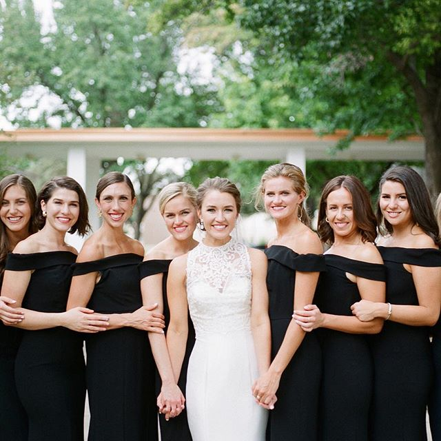 Classic black and white bridesmaids dresses and a simply stunning bride in white!