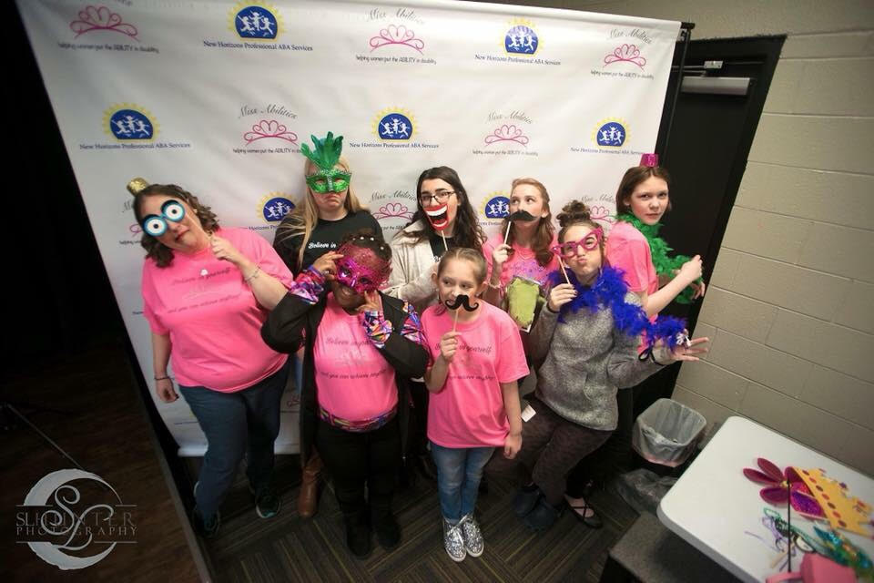 2018 Beauties pose with volunteers for our photo booth backstage before the pageant begins
