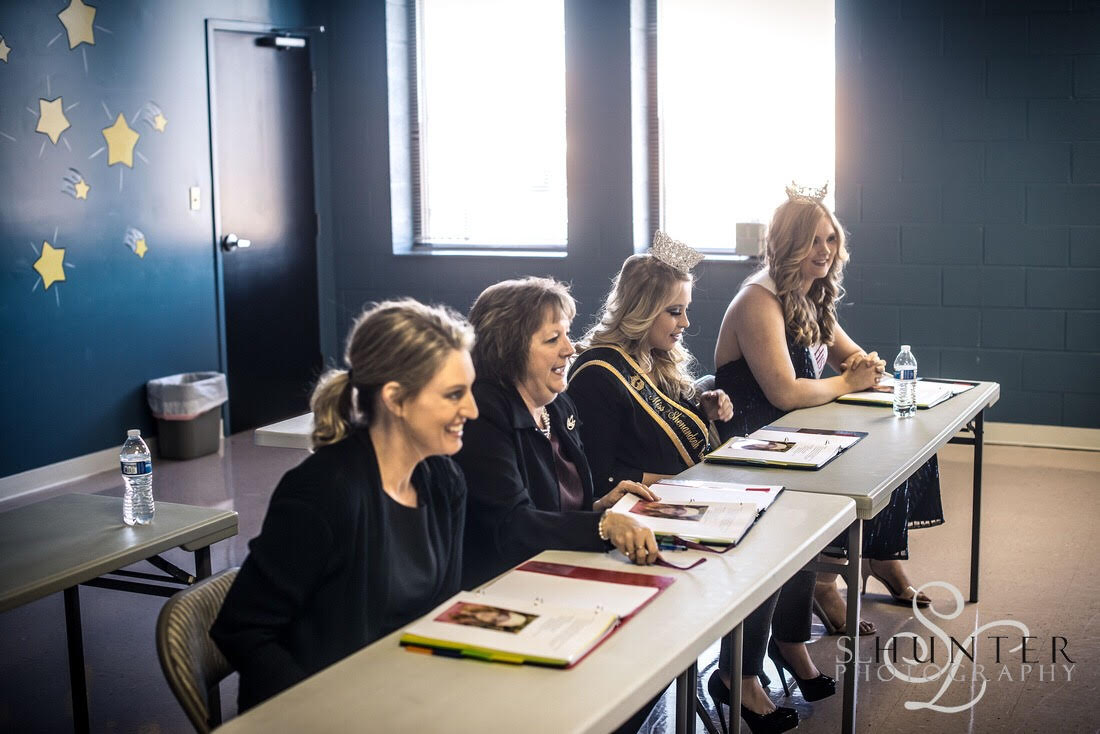 The 2018 Judges panel laughs with a Beauty during the Interview category