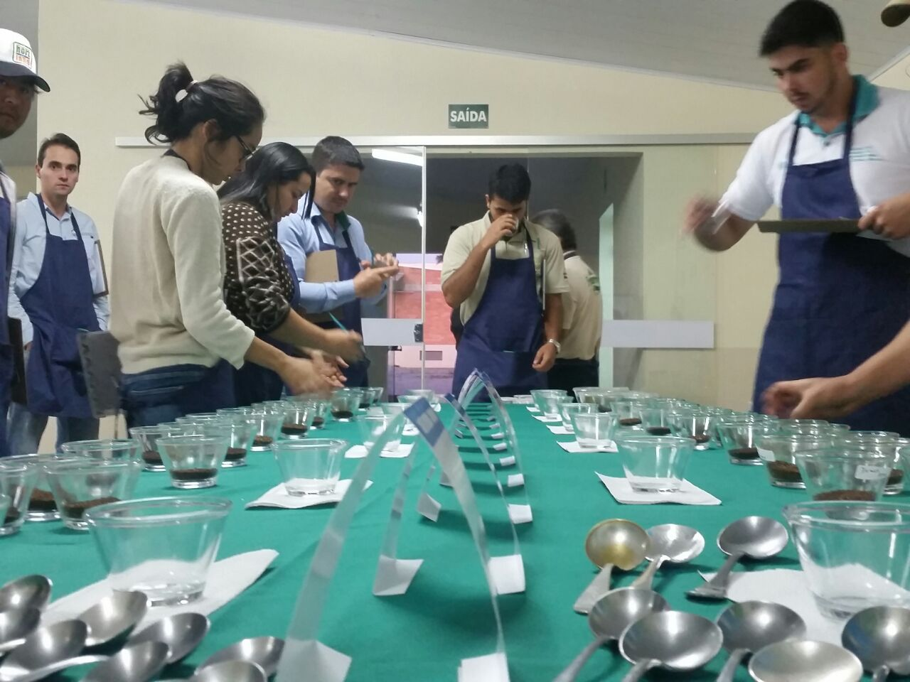 Coffee producers and their team cupping coffees from several countries of origin