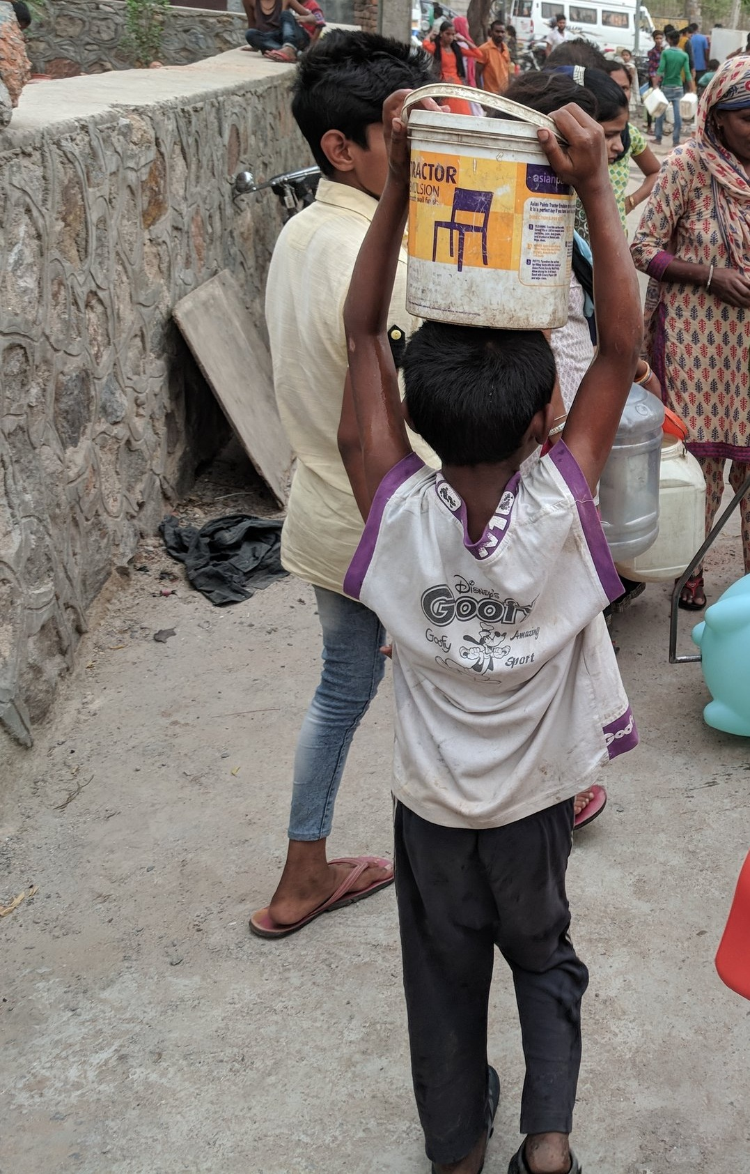 Fetching Water - Women and children are often responsible for carrying heavy containers of water home multiple times per day. This consumes most of their time and causes chronic pain.
