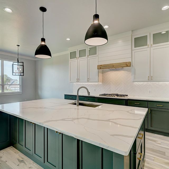 Love the gold and black metals mixed with white quartz countertops!  #bridgewayhomesokc