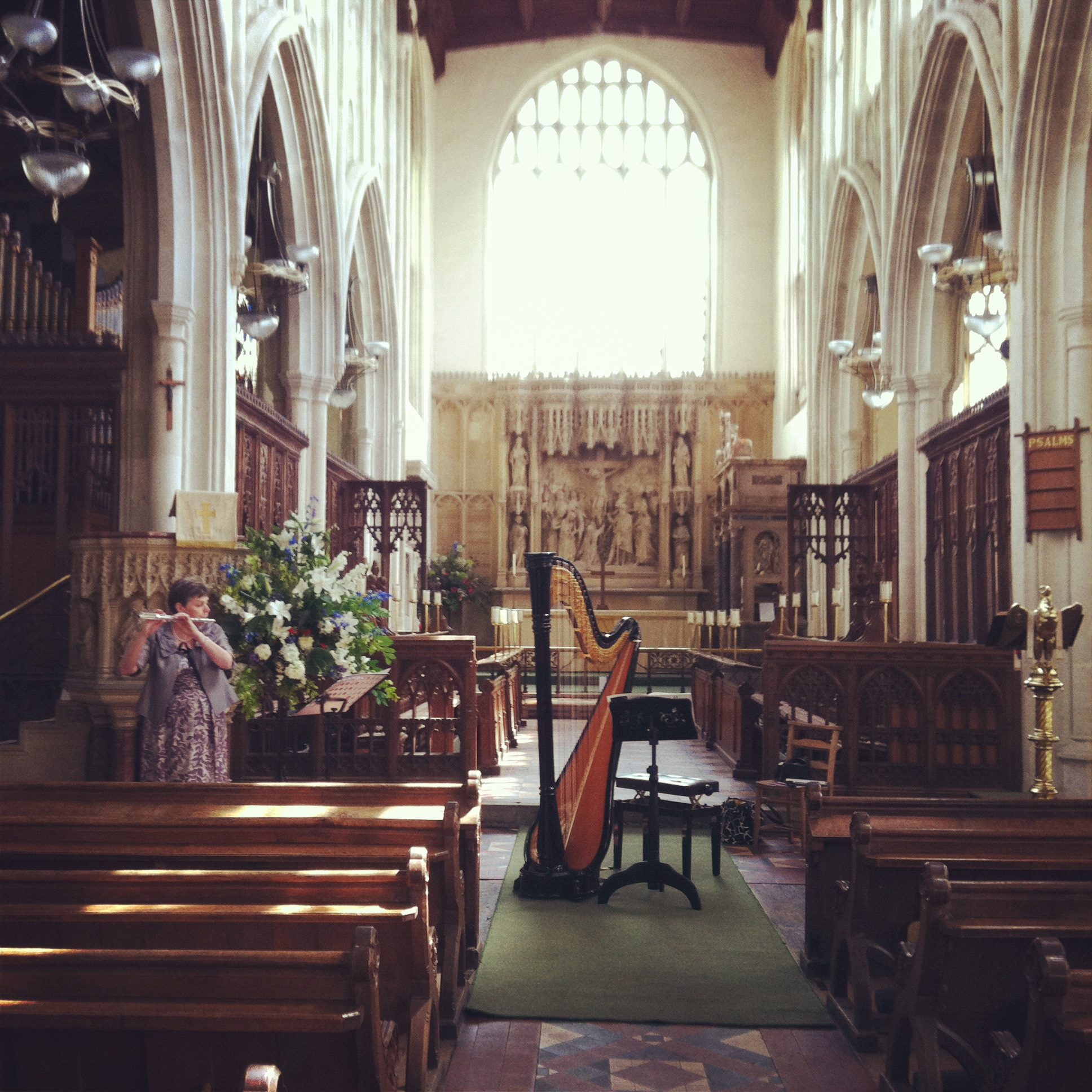 Warming up for a recital in Long Melford church with my flautist mum