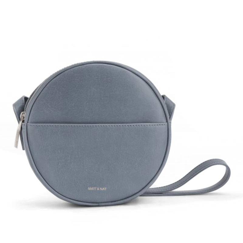 - Mat and Nat, Obe Bag in Frost, $130In the perfect shade of gray-blue to bring an accent of color to an outfit without competing with it, this Mat and Nat purse is Vegan to boot.