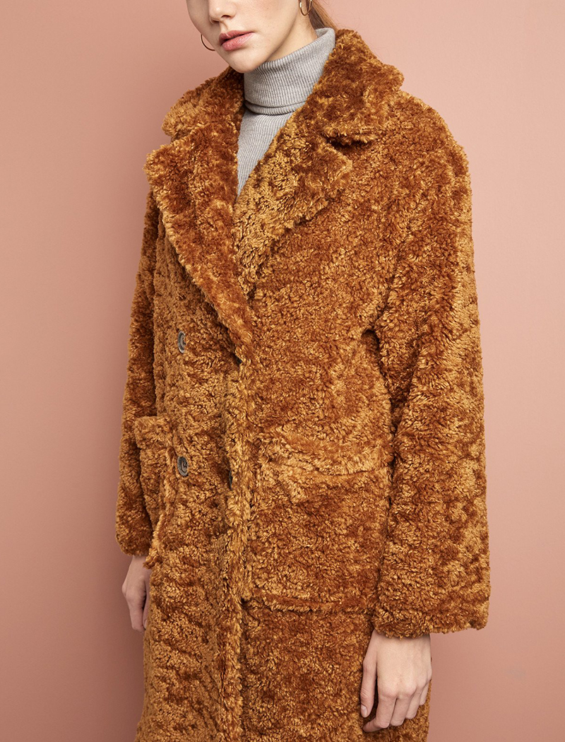 - Pixie Market, Teddy Button Faux Fur Coat, $250The golden hue of this piece gives the texture added dimension.