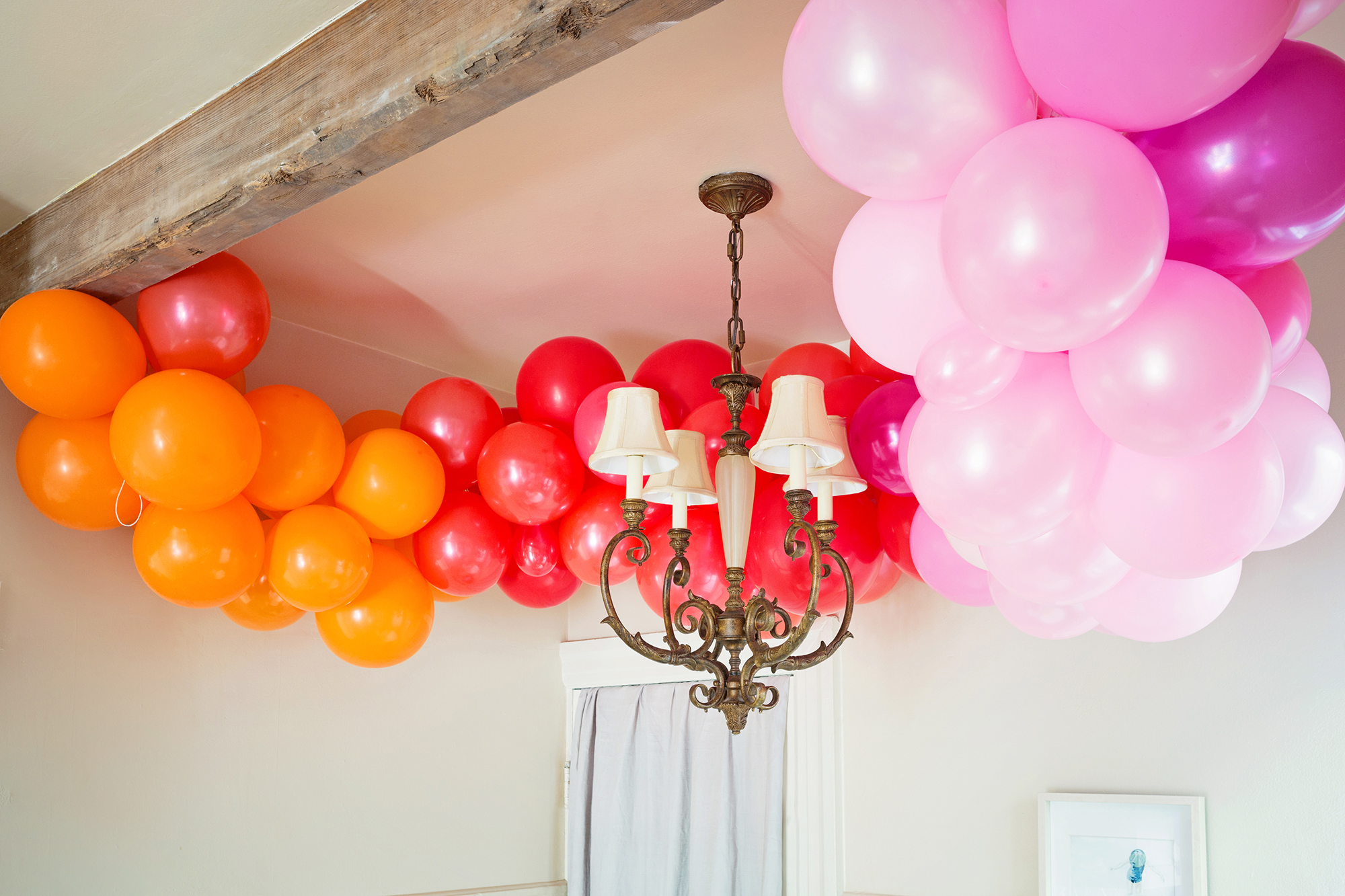 The Easiest DIY Rainbow Balloon Arch | Design Confetti