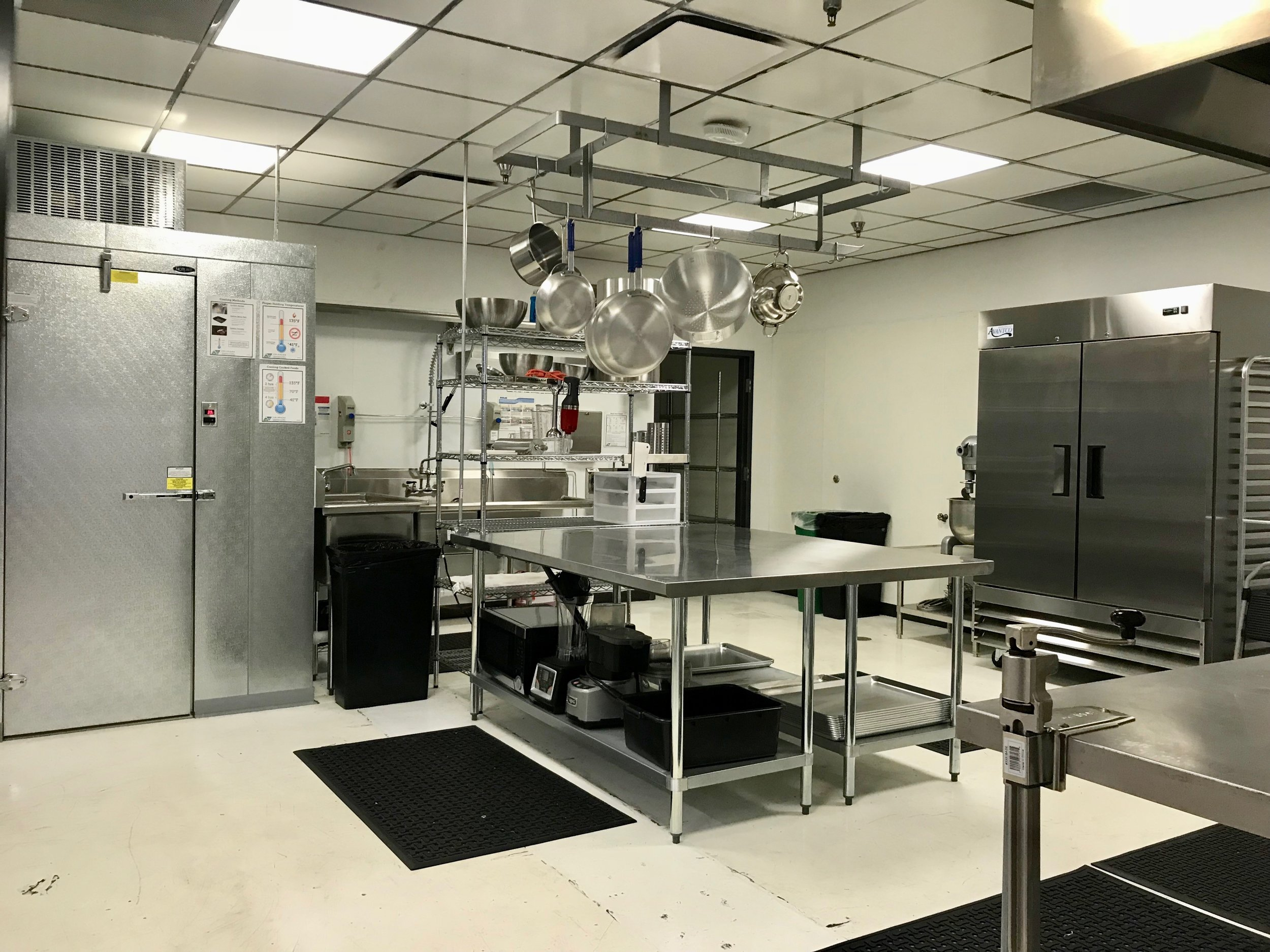 KITCHEN - NOT ONLY IS IT A BRAND NEW, FULLY-EQUIPPED COMMISSARY KITCHEN, MEMBERS CAN ALSO TEACH COOKING DEMOS, UPDATE THEIR WEBSTORE ON THE INTERNET OR SCHEDULE A MEETING IN A CONFERENCE ROOM