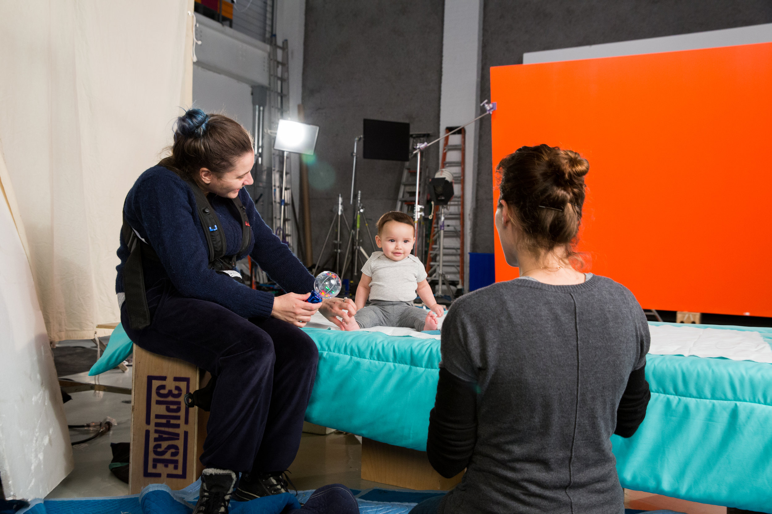 Brooklyn Studios: BOON Inc shoot  Mom and baby wrangler making sure talent is comfortable, happy, and taken care of.