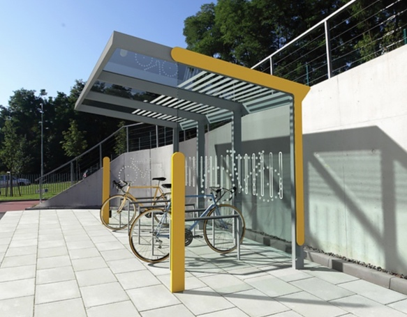 AUREO VELO :BICYCLE.SHELTER - Structure has a high roof protecting bicycles parked underneath. Increased height enables optional two-tier bicycle parking. Walls are made of tempered glass with safety serigraphy. Equipped w/ integrated drain.