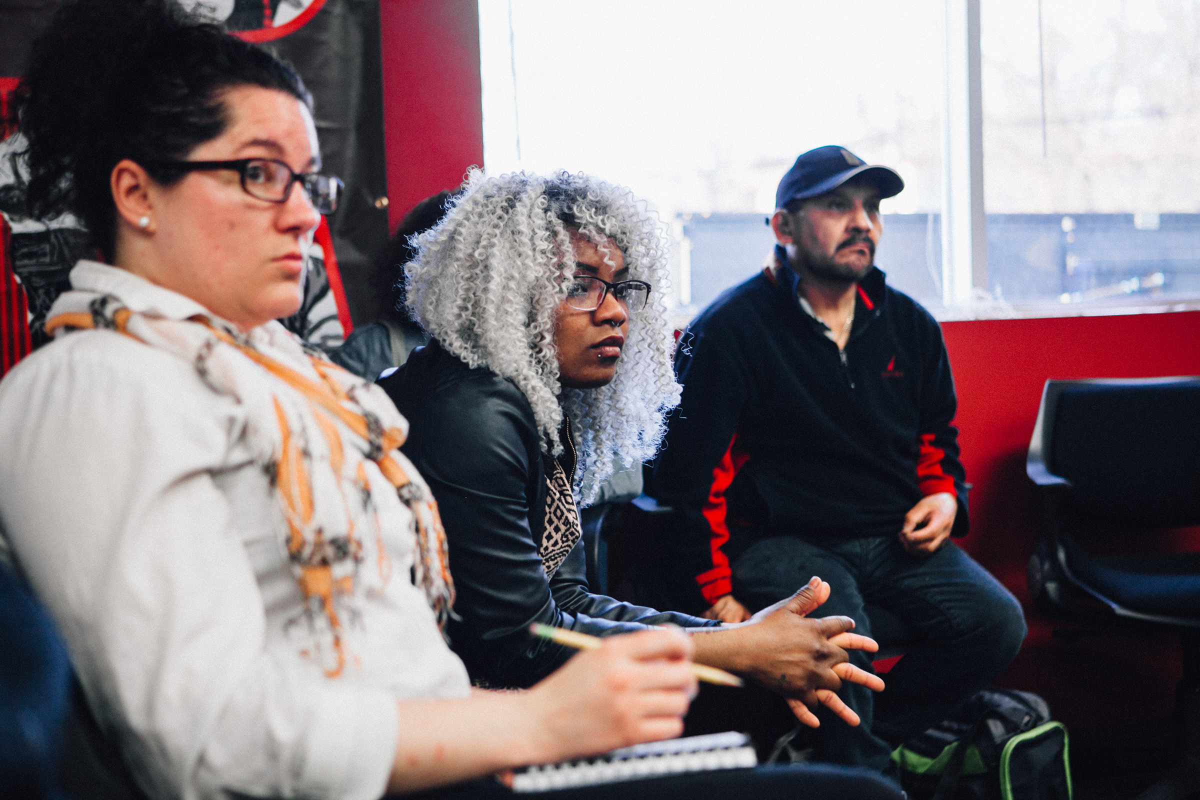Inquilinxs Unidxs members listen while a fellow renter describes her struggle with substandard housing conditions.