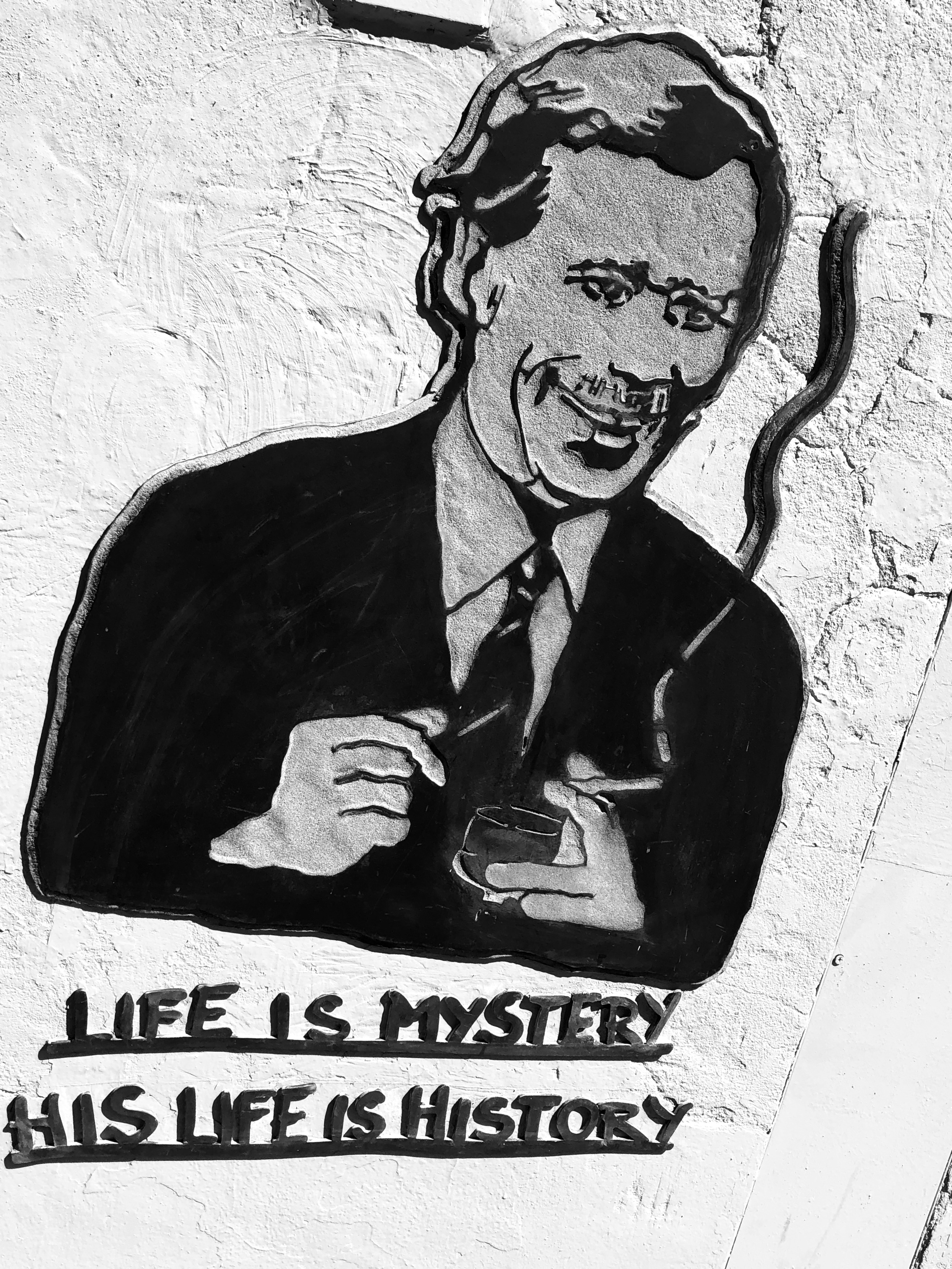 """""""Life is mystery, his life is history"""": Vaclav Havel portrayed on a wall in Kampa Island. Prague, Czech Republic"""