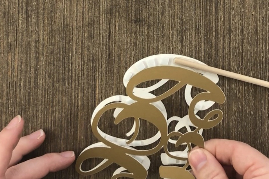 cake topper pieces cut with Cricut are assembled.jpg