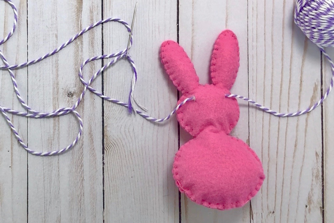 Assembling Cricut Easter Bunny felt banner with twine